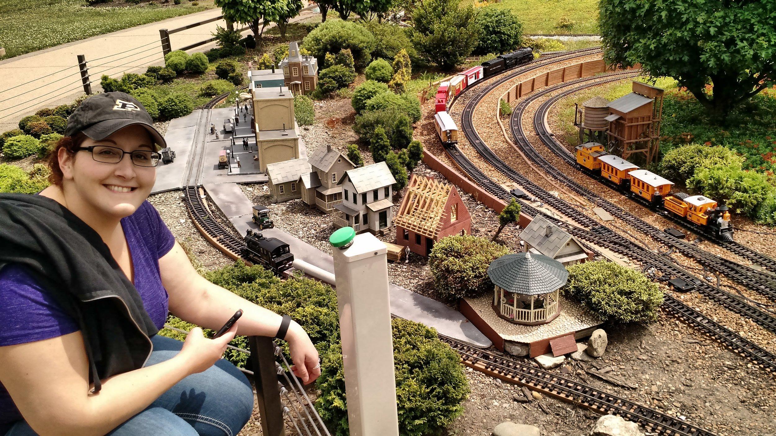 Jen admiring the miniature train set.jpg