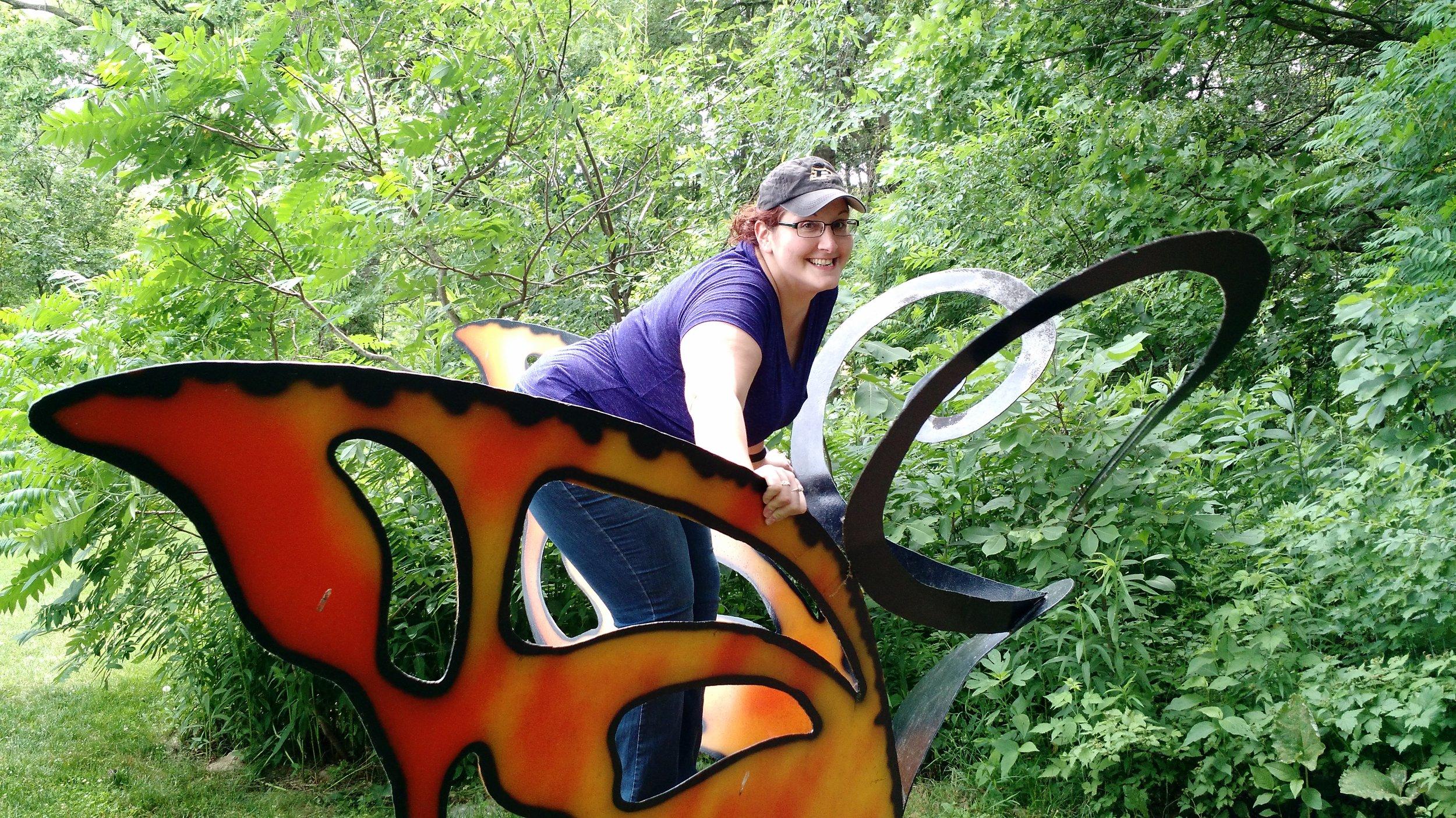 Jen flying on large butterfly.jpg