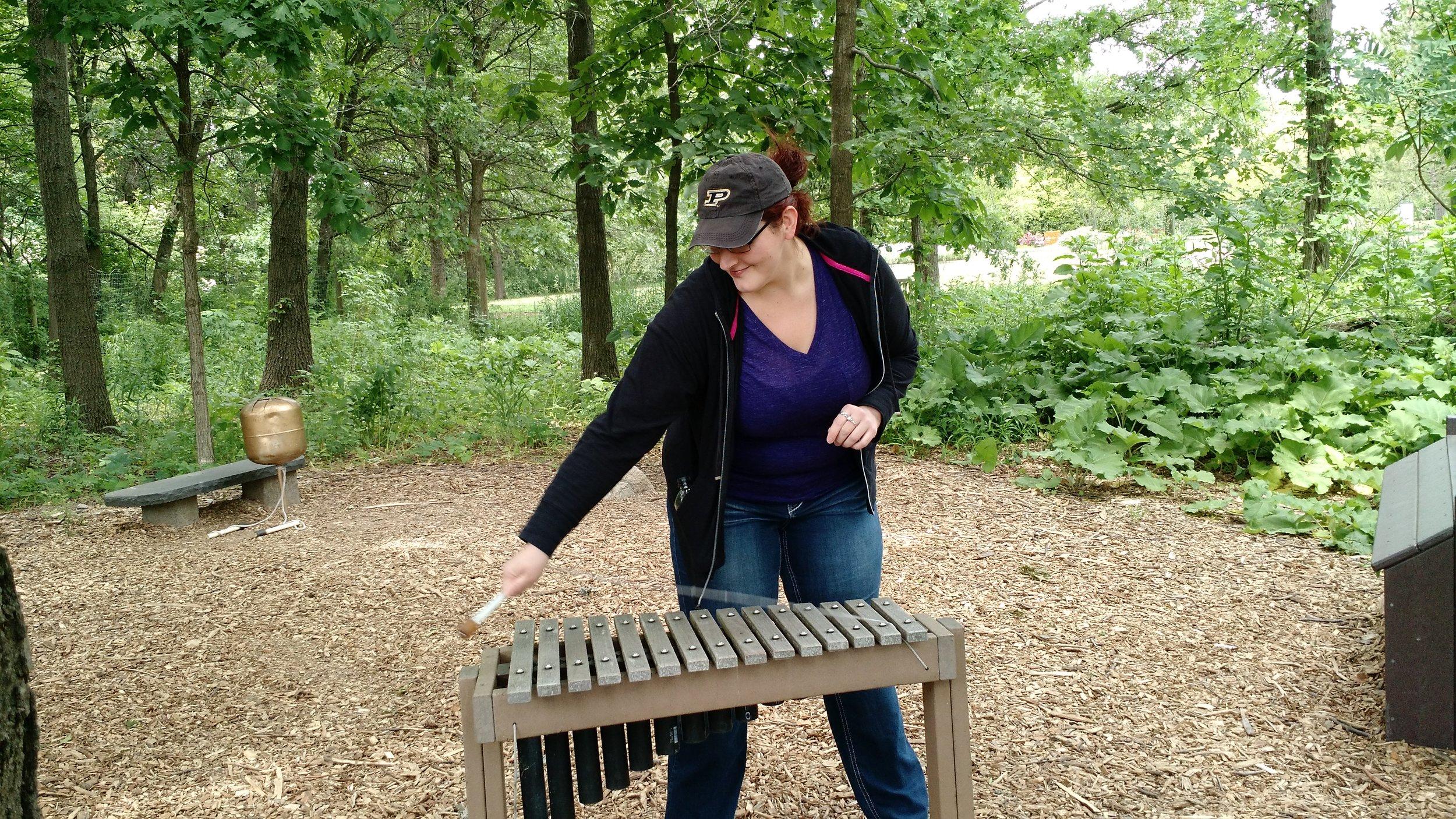 Jen playing outdoor xylophone.jpg