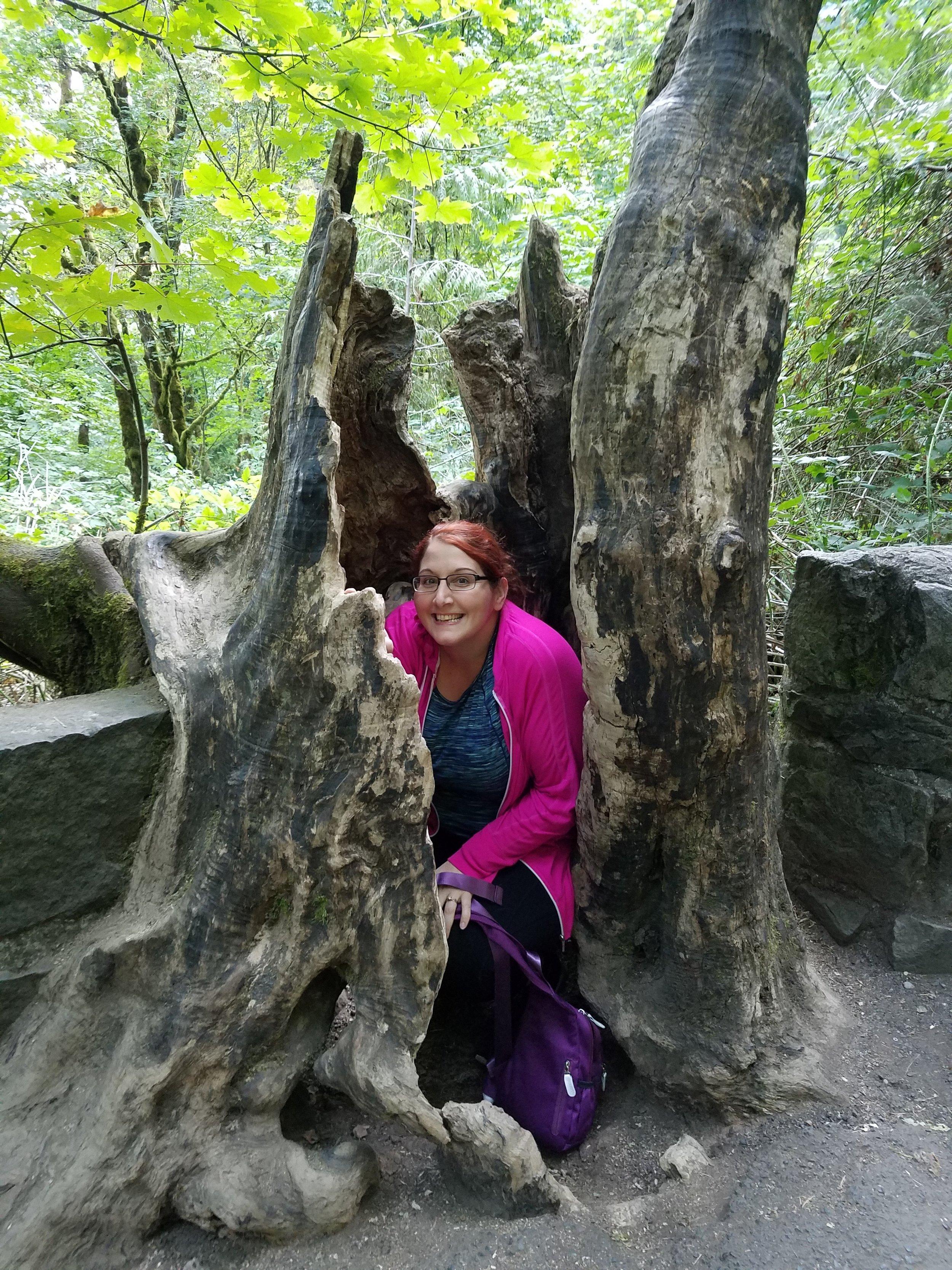 Jen hiding in a tree stump.jpg