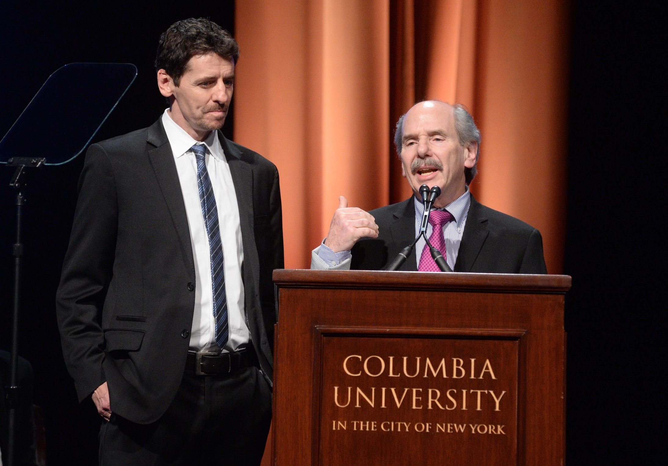 """Danny Zwerdling (left) and Michael de Yoanna accept the duPont-Columbia Award for their reporting, """"Invisible Wounds."""""""