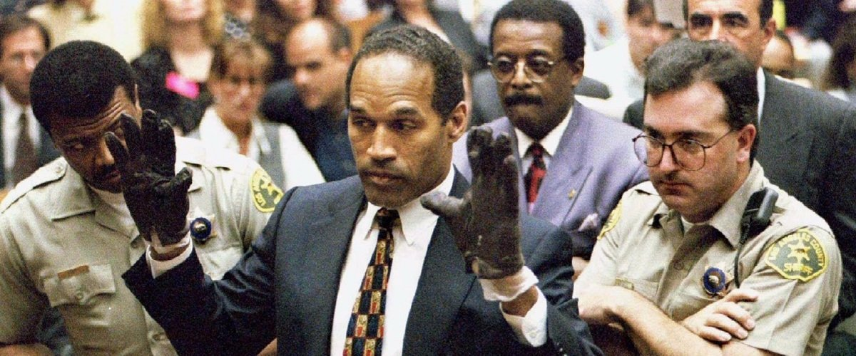 O.J. Simpson trying on gloves during the climax of his trial in Los Angeles, California.