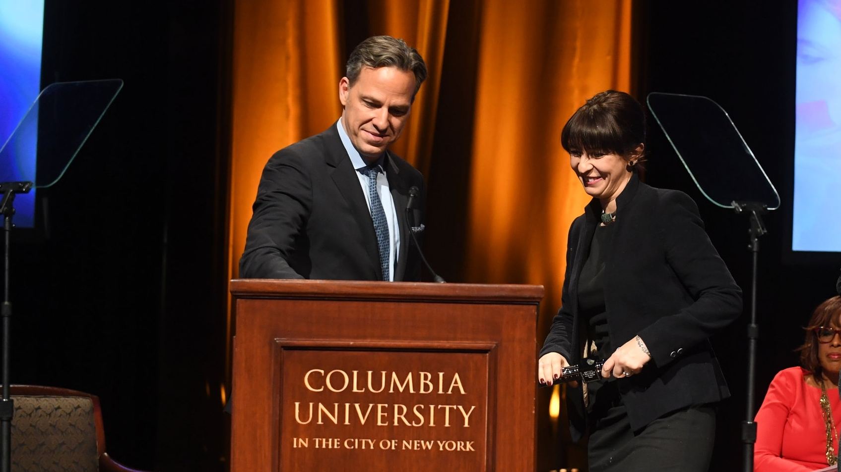 Natalia Antelava accepts the 2018 duPont-Columbia baton from host Jake Tapper at January's ceremony.