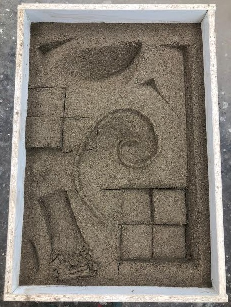 Mixed and we the sand, waited an hour to let clay and sand dry slightly-then made relief pattern