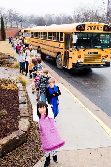 Children leaving buses at WAC.jpg