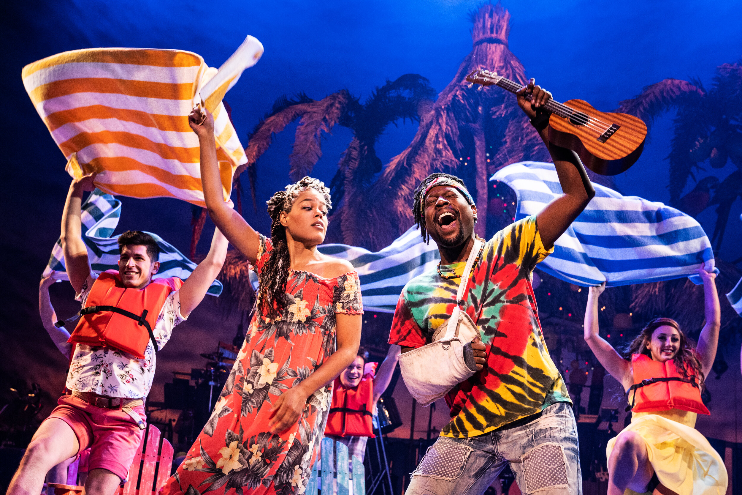 Rachel Lyn Fobbs as Marley, Matthew James Sherrod as Jamaland Companyin Jimmy Buffett's ESCAPE TO MARGARITAVILLE. © Matthew Murphy
