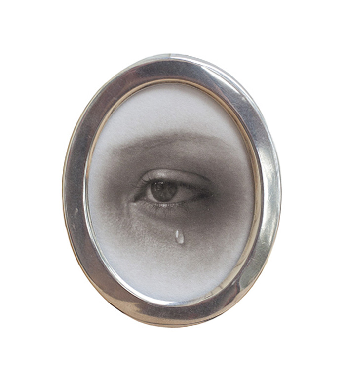 Julia, Crying  Pigment print, miniature sterling silver frame