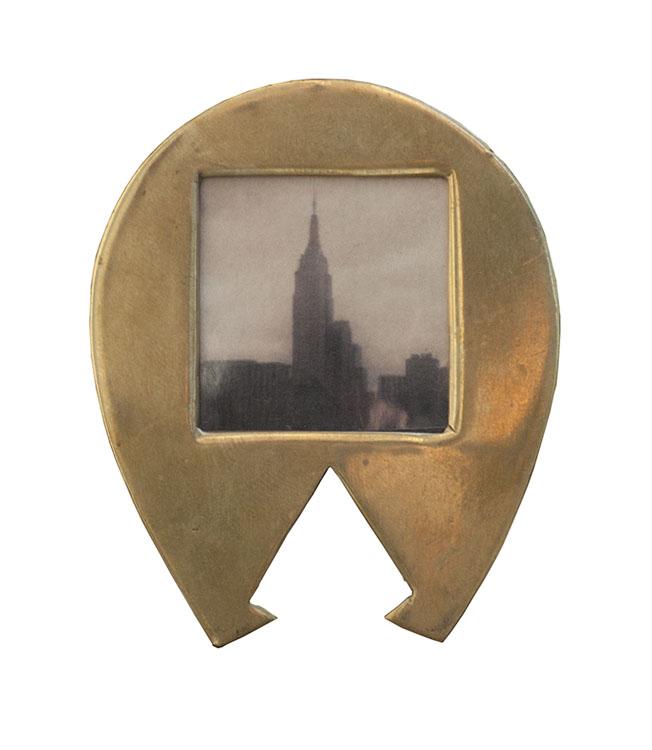 Empire        Pigment print, miniature antique brass frame