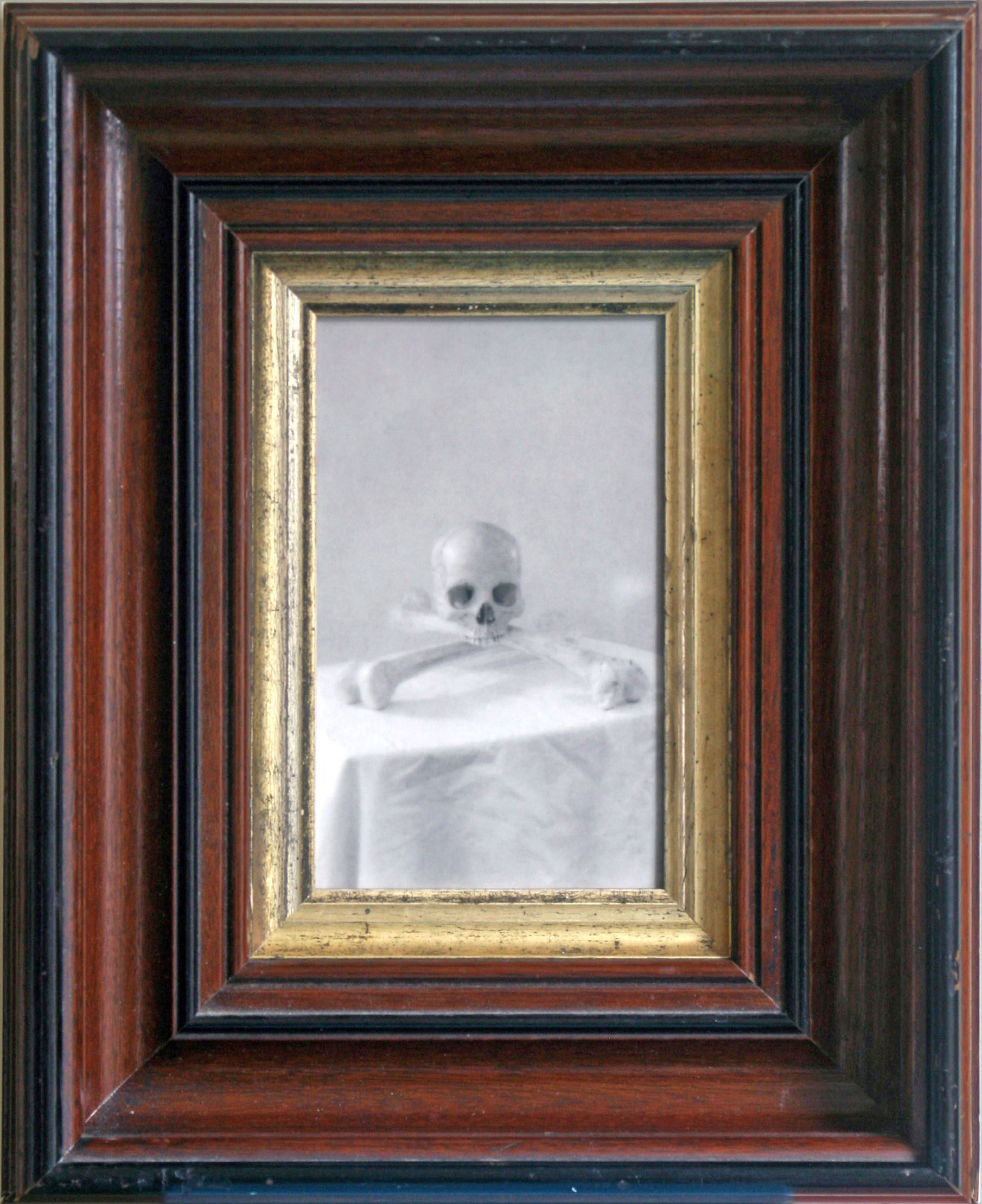 Skull and Crossbones                 Silver gelatin print, antique frame