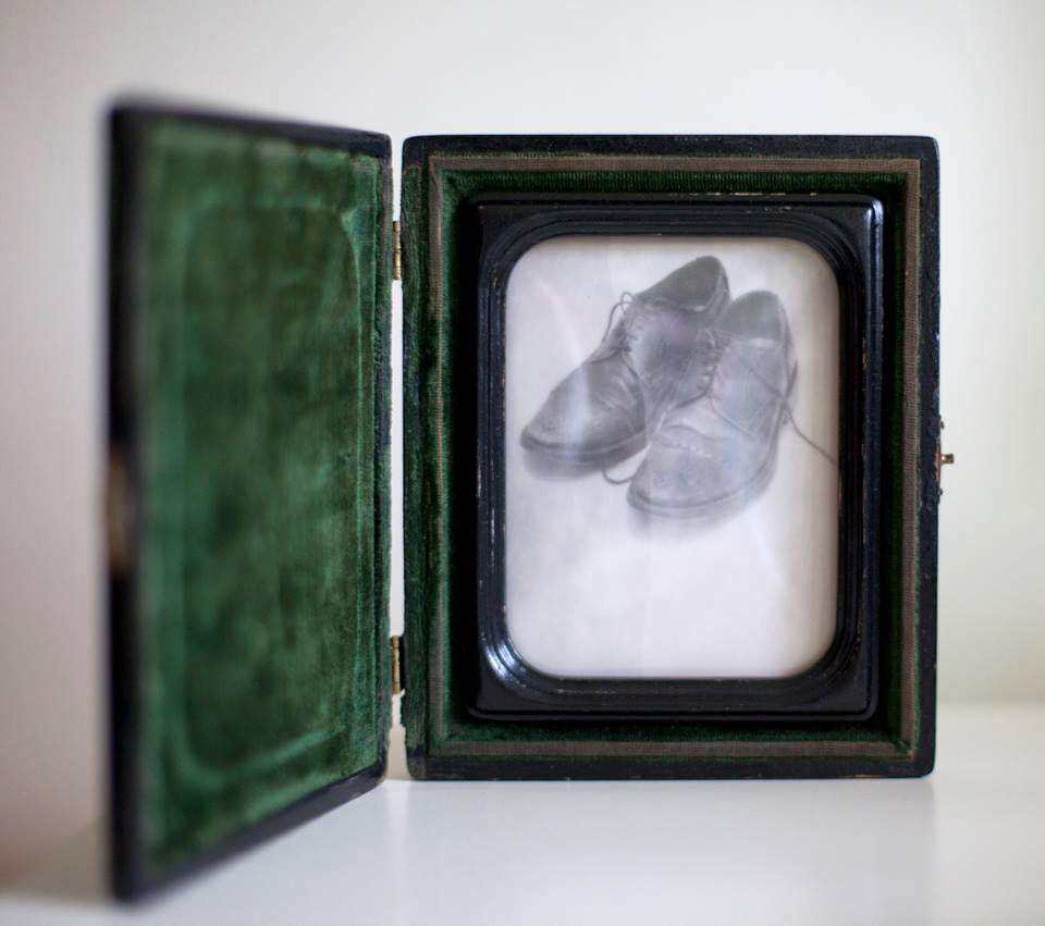 My Wingtips     Silver gelatin print, antique carrying case