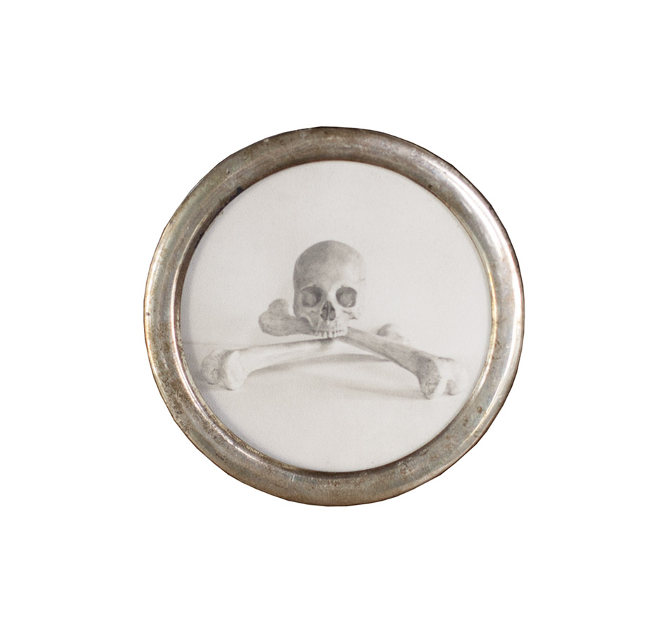"Skull & Crossbones   pigment print, antique silver frame    2"" diameter"