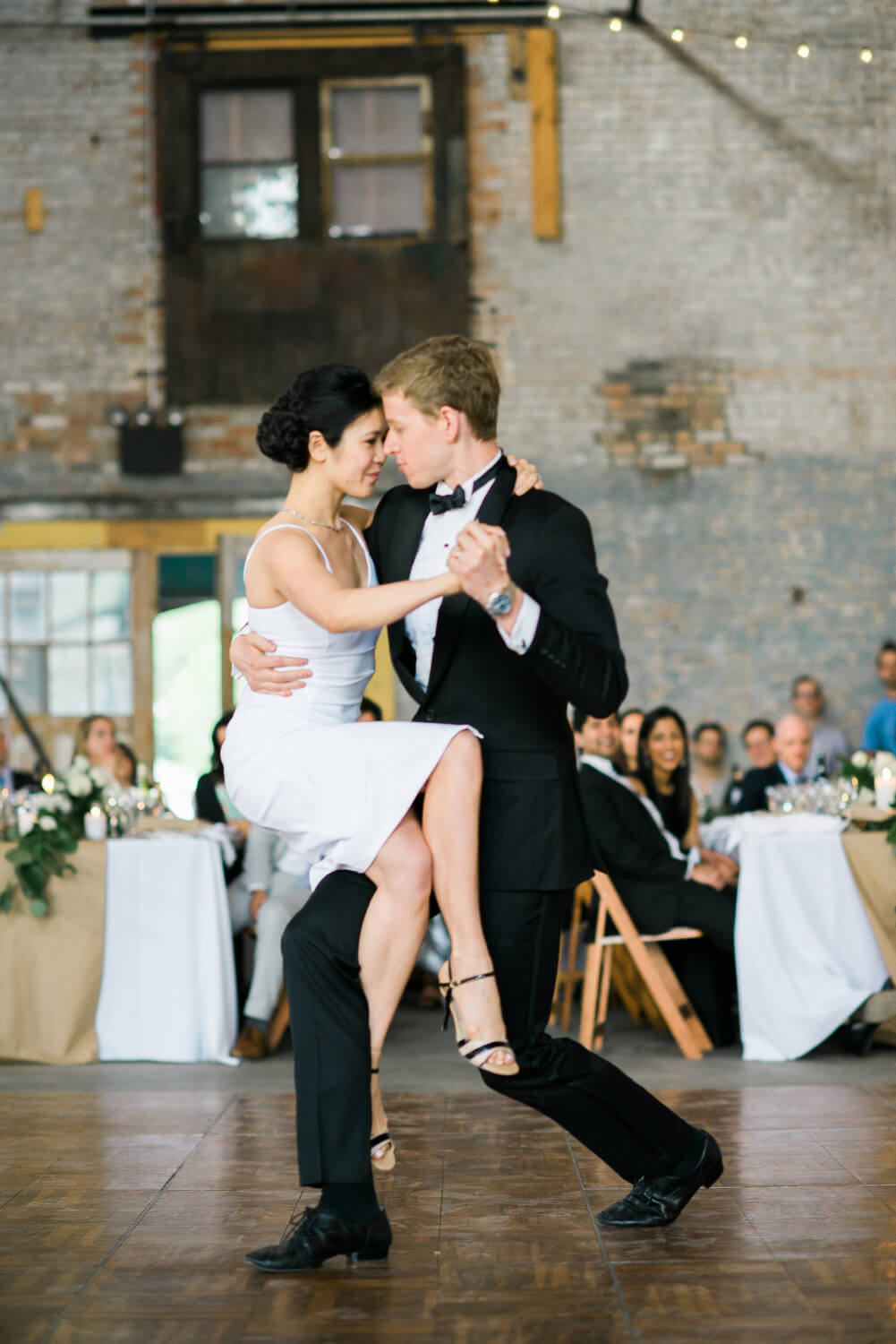 Geoff and Tze dancing a Tango Choreography at their wedding