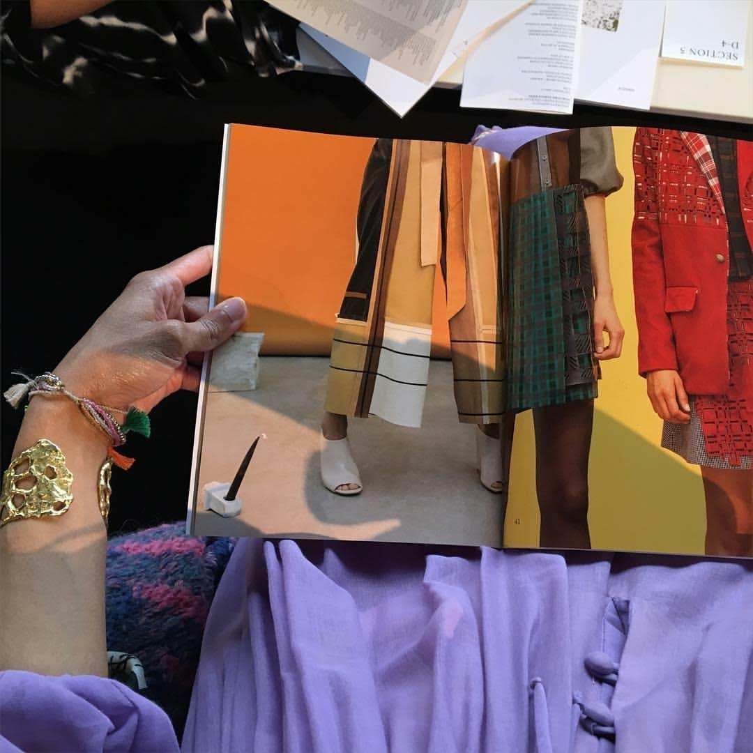 Seated at the Pratt Fashion runway show, 2016–70s lilac cotton Bohemian dress and 80s sweater, Beacon's Closet, NYC; brutalist gold cuff