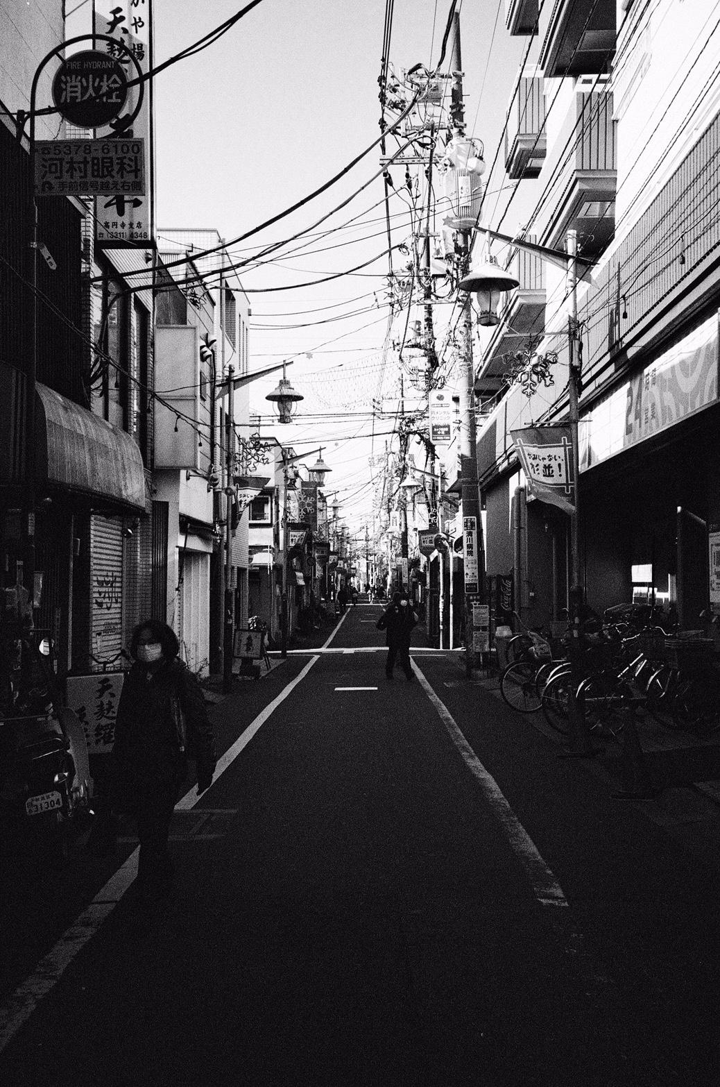Tokyo, Japan in 35mm black & white film. Ryan Adams Prisoner Tour December 2016.