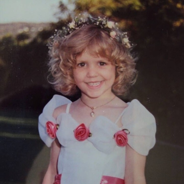 Myself as a flower girl at my uncles's wedding. I was three.