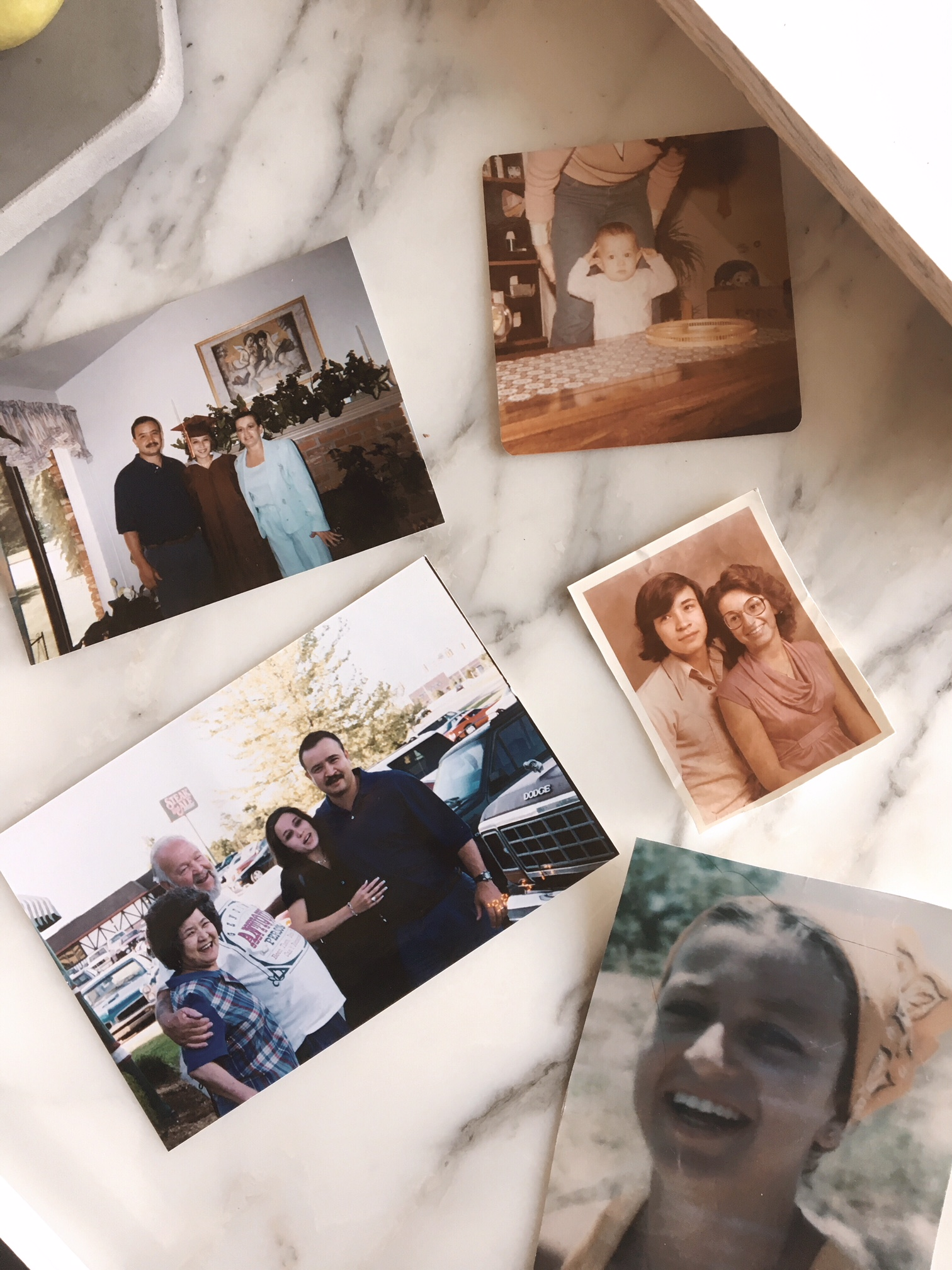 Old photos of my mom, dad, and grandpa and grandma