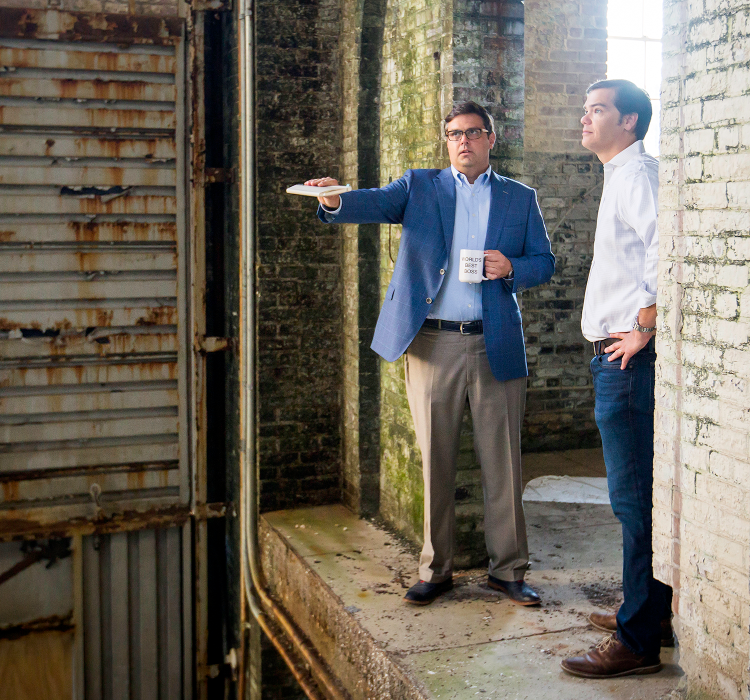 Architect Dyke Nelson, left, and DNA Workshop staff member Abe Kinney inspect the old Entergy building site on Government Street.