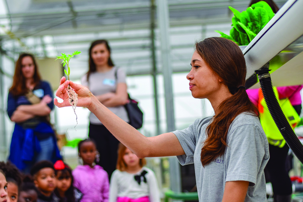 Farm Manager Maureen Thiessen teaches schoolchildren on a their field trip to Purple Martin Farm in Raleigh. The school is next door to 5401 North, a development by Commercial Properties Realty Trust and the Baton Rouge Area Foundation.