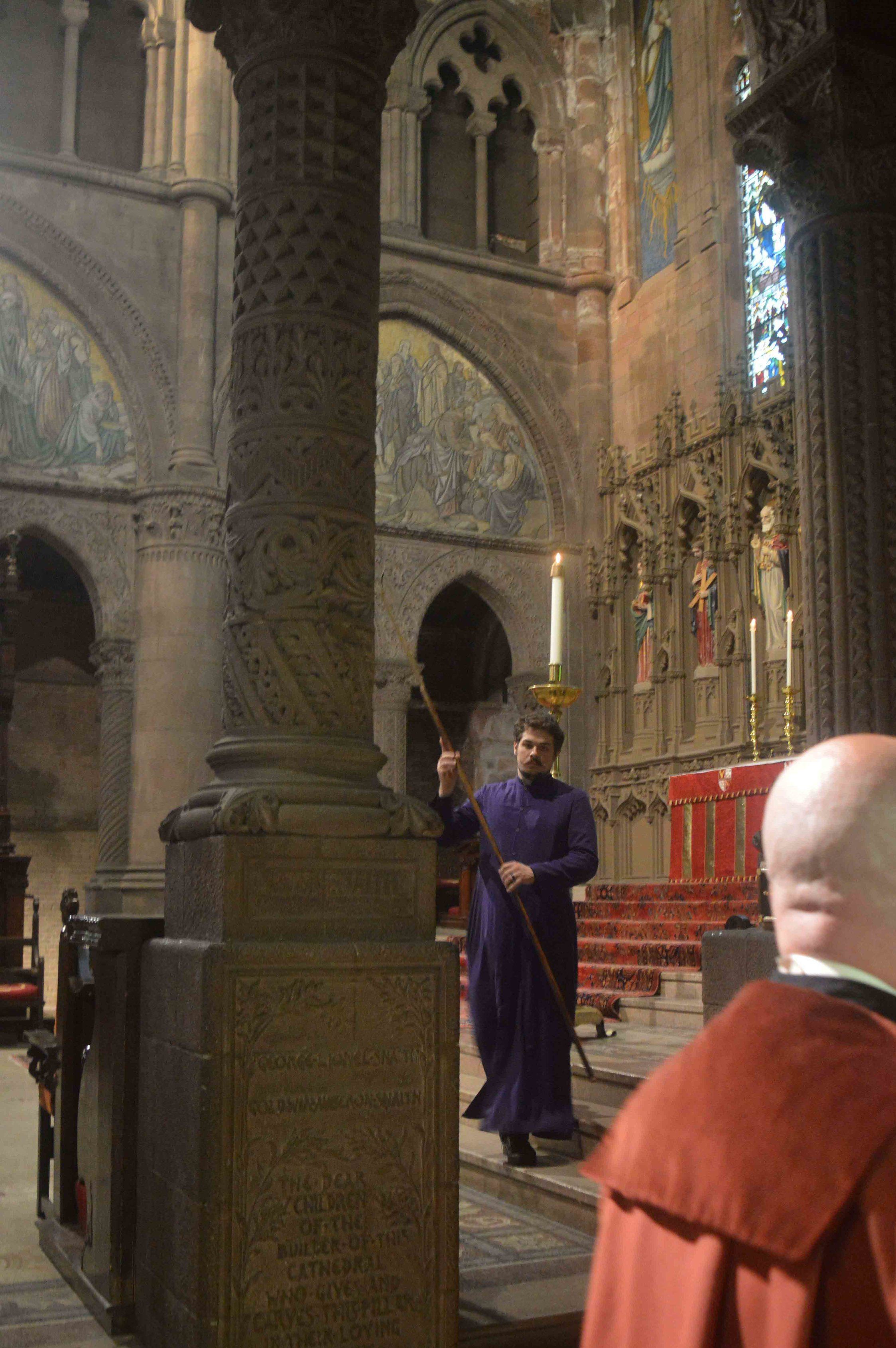 Evan Craig Reardon, one of the presenters of the  T.S. Eliot workshop  beginning in October, lighting candles before Evensong on June 9.