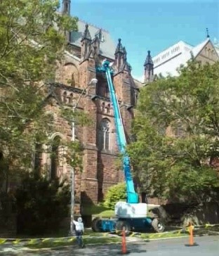The lift repairing the damaged shingles over the Lady Chapel