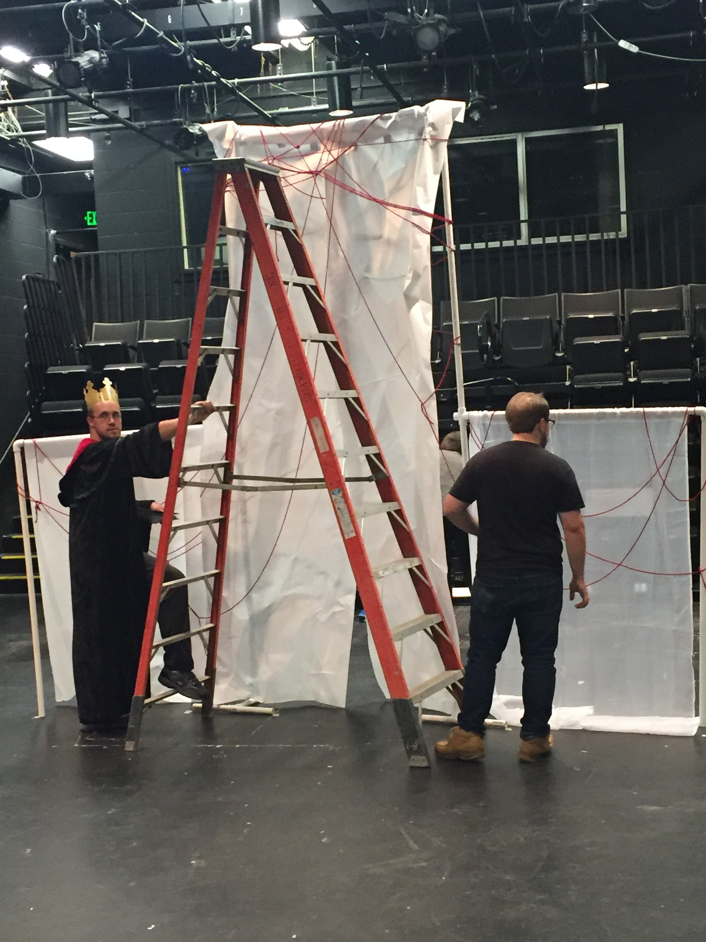 Nate Driscoll (Duncan) and Chance Parker (Macbeth) working on group one's set design, creatively incorporating the materials provided.