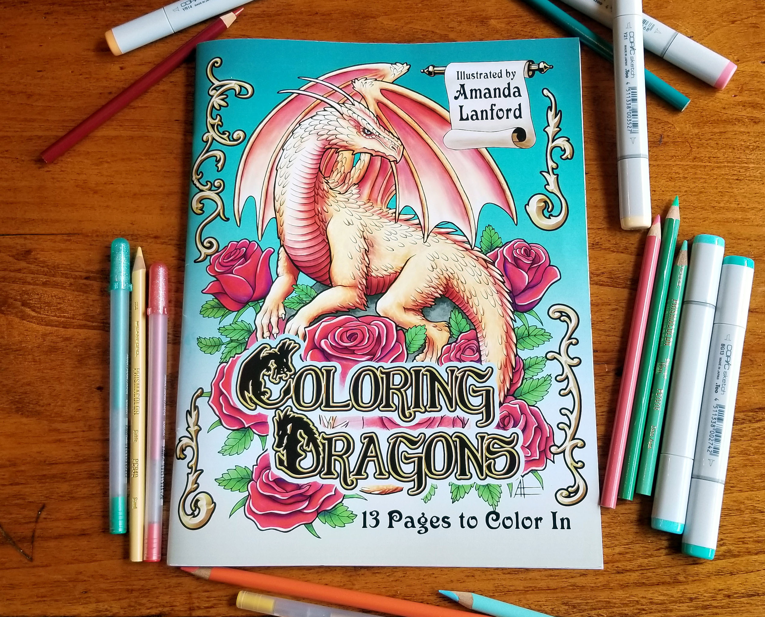 Here Be Dragons…To Color! - This fantasy coloring book contains 13 detailed pages of artwork featuring all sorts of dragons, from tiny hatchlings perched on a flower to mountain-sized monsters and everything in between.