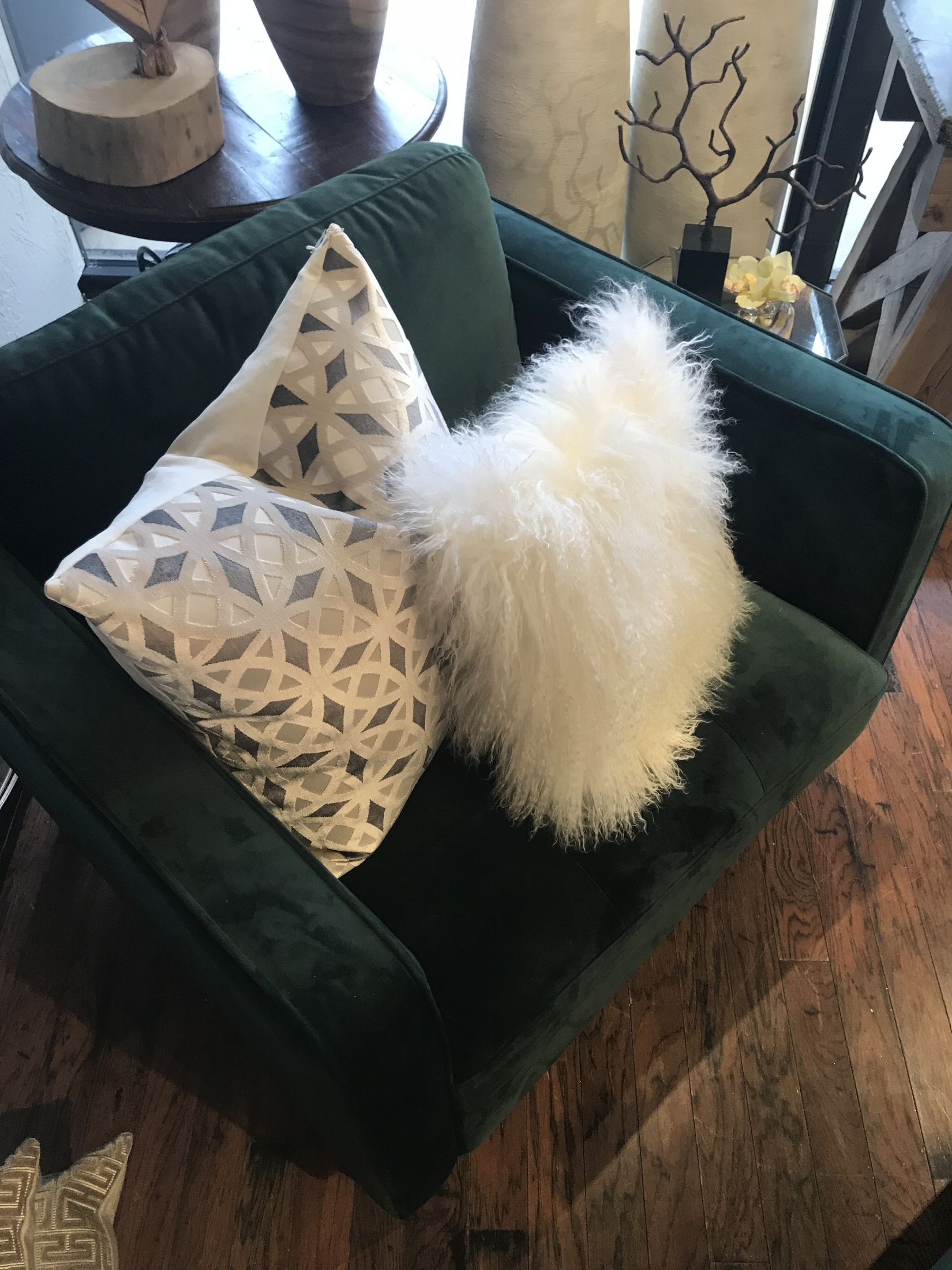 Toss On Some Pillows - I know you are tired of me saying it, but pillows will do wonders for your home. This emerald chair gives off bold vibes the instant it snatches your attention. Pillows will help define your chairs mood. Throw on some silvers and fur for a tiny bit of neutral glam, or take it to the next level of bold with a white and hot pink lumbar.