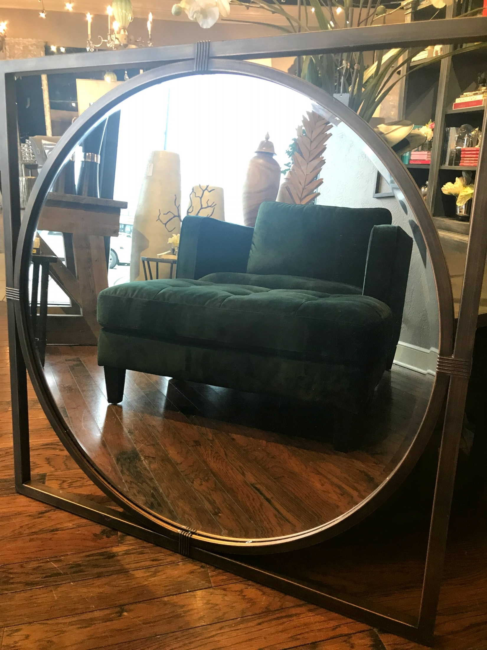 Objects Of Interest - This green chair has a personality all it's own. Adding other eye catching pieces such as a unique article for the wall, a bright floral, or some quirky lamps will help tie together the origonality of the space.