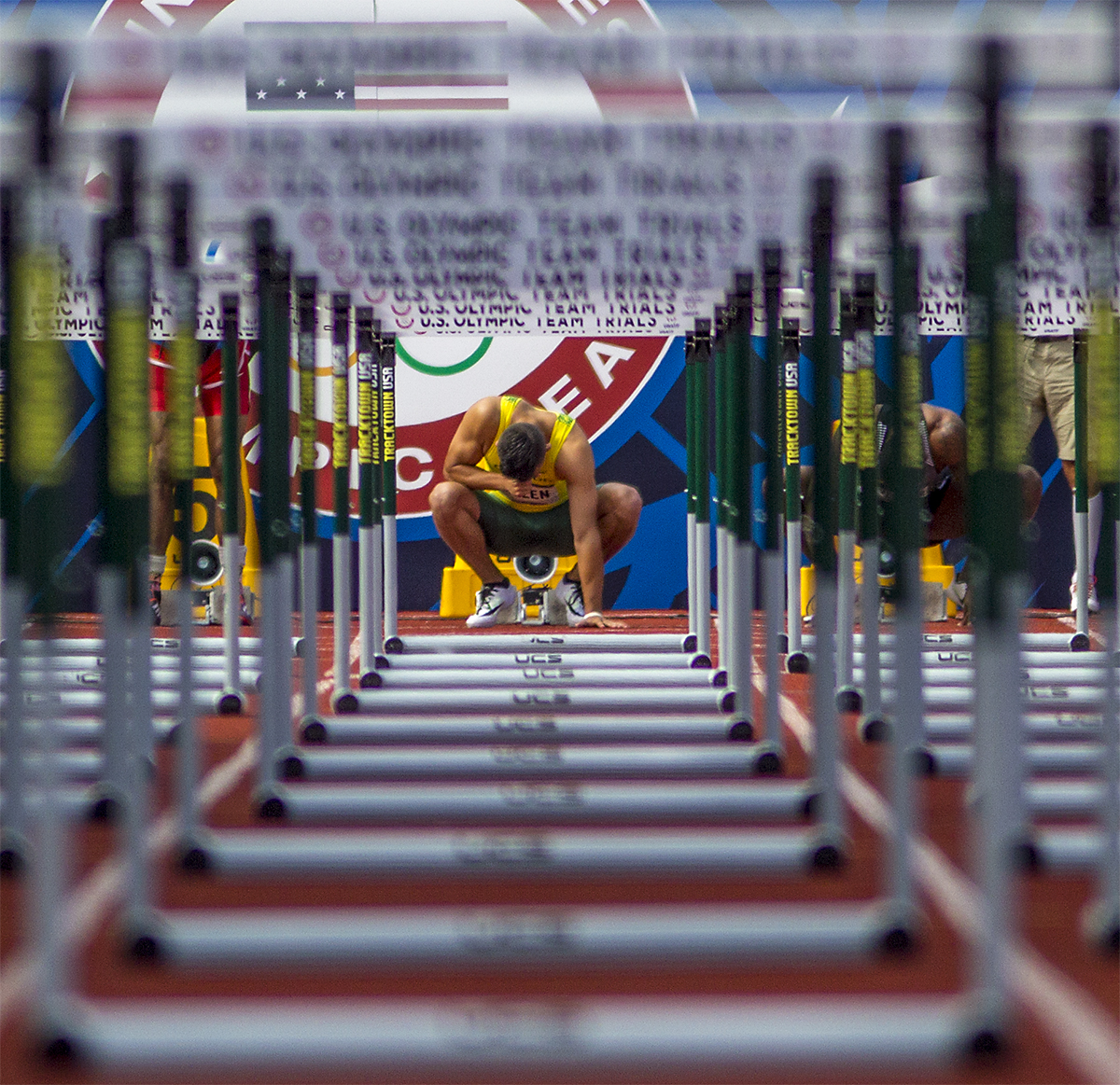 Oregon's Devon Allen performs the sign of the cross before competing in the semi-finals of the 110 meter hurdles at the Olympic Trials. Allen would win his heat in the semi-finals and go on to win the final in 13.03.