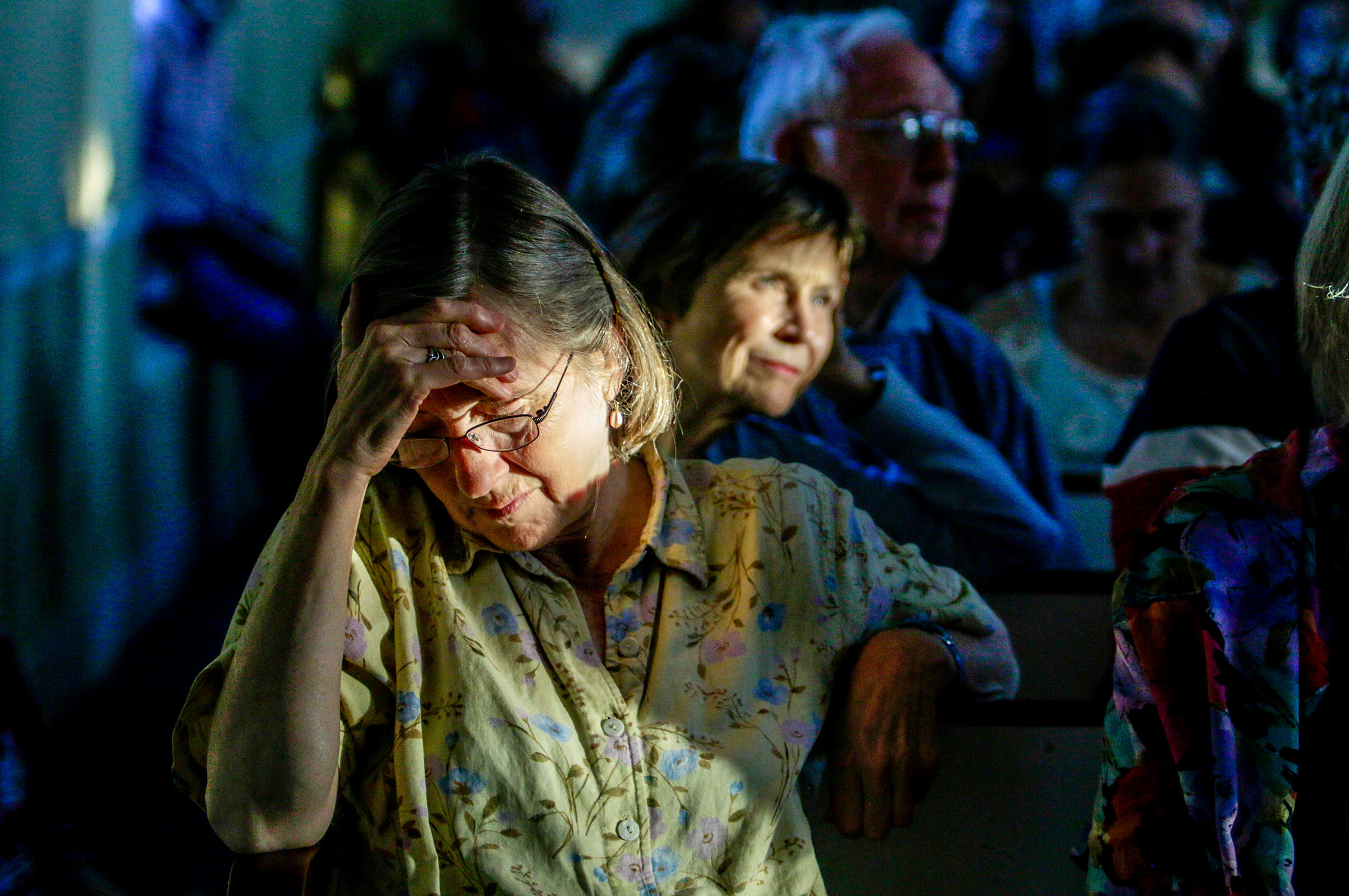 Pam Kneisel reacts to an account, told by Congressman Peter Welch, D-Vt., of what children have gone through in the wake of President Donald Trump's immigration initiative on Wednesday, June 20, 2018 at the Thetford Hill Congressional Church, in Thetford, Vt.