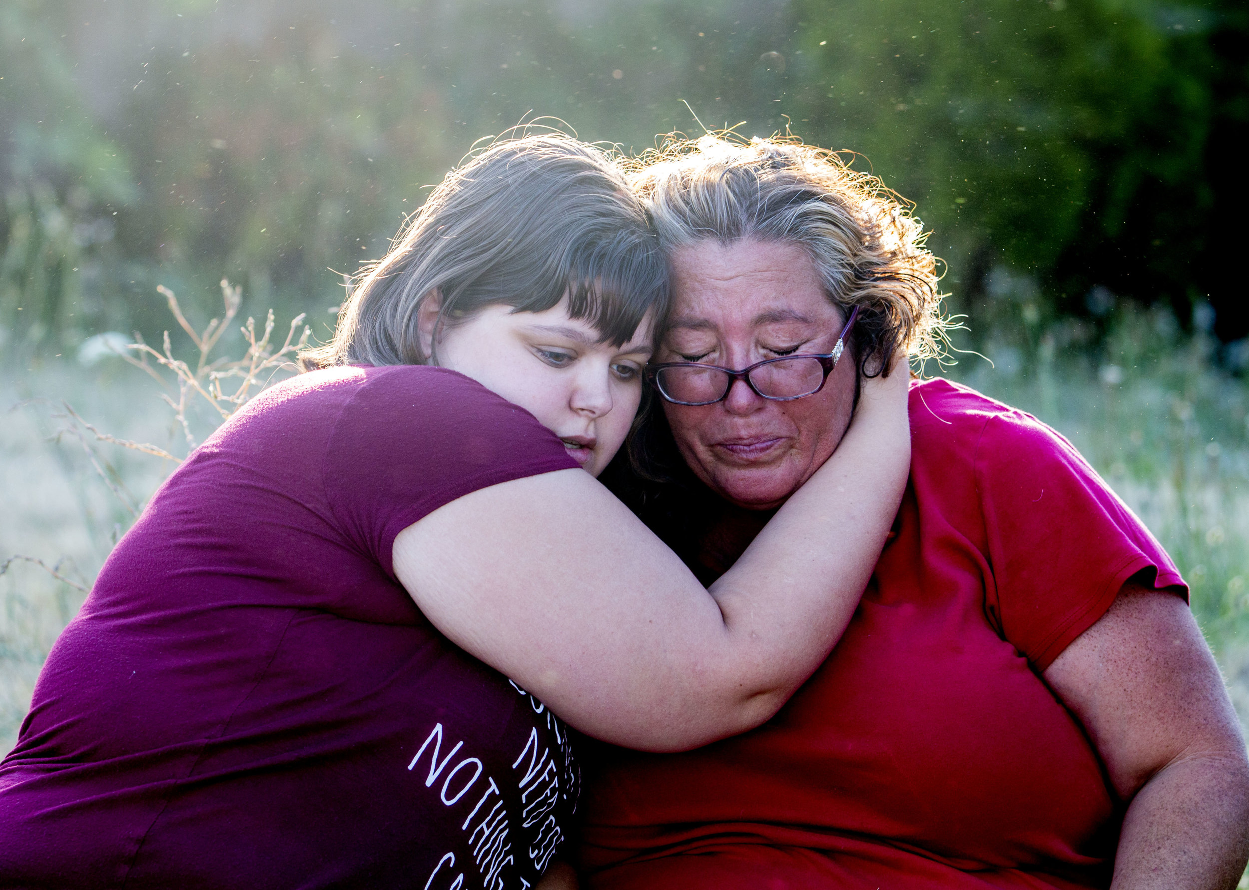 Breanna Evans (left) consoles Jean Schaible after Schaible's mother's house went up in flames on her mothers birthday. Both Schaible and her mother Shirley Henson were able to safely make it out of the house with the help of neighbor Nolan Nease, 19, who ran into the house and helped carry Shirley and her wheelchair to safety. The damage to the house made it inhabitable, meaning it would have to be torn down.