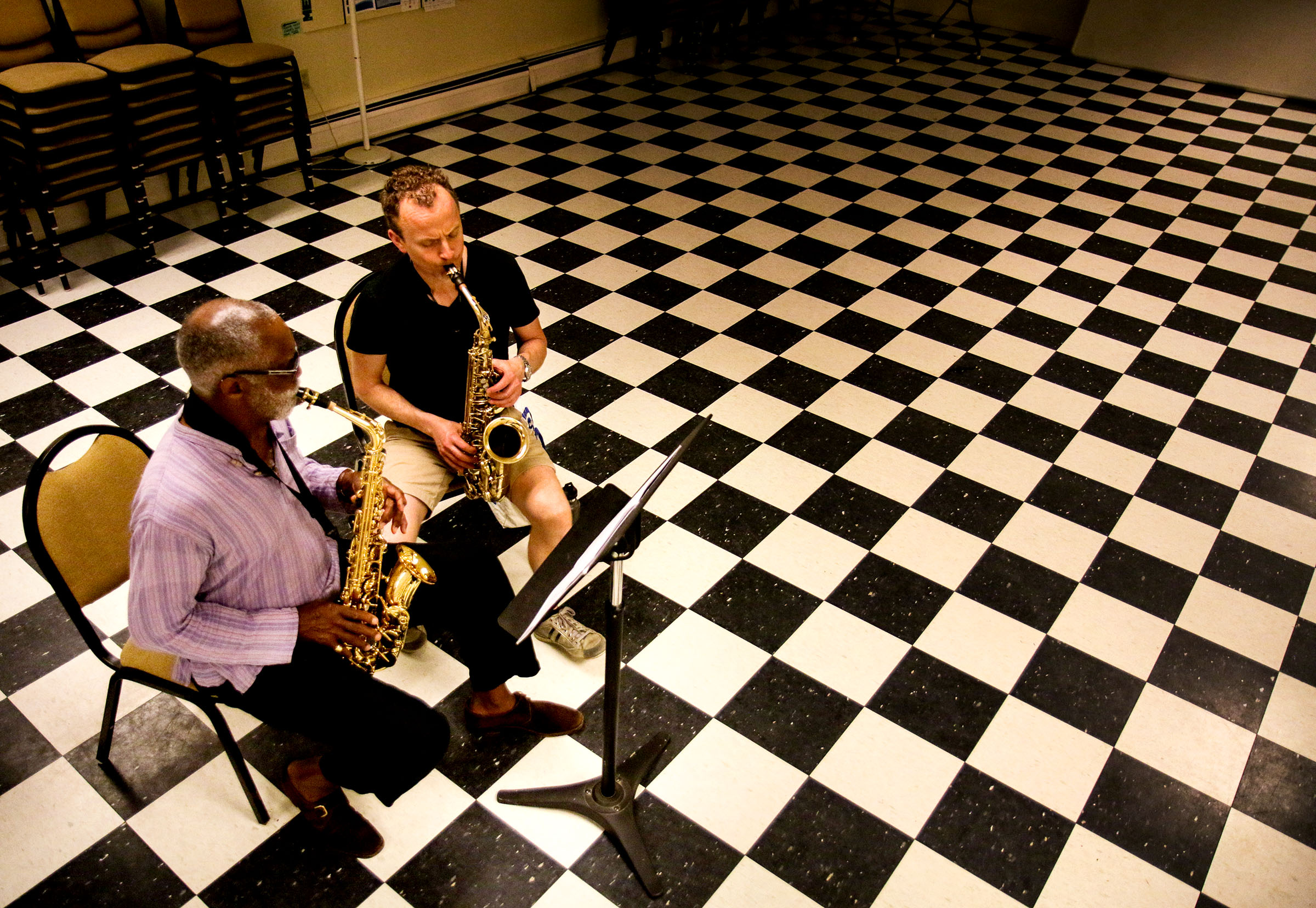 """Mendon, Vt., resident Al Wakefield, left, takes a lesson from Dartmouth classical saxophone lecturer Michael Zsoldos, of Woodstock, Vt., at The North Chapel in Woodstock on Wednesday, July 11, 2018. Wakefield was one of 70 students Interplay Jazz brought together for a summer program, and he is now applying the basics he learned there. After a life as a """"corporate guy,"""" music functions as a way for Wakefield to get his emotions out. """"At this stage in my life, it brings me great joy,"""" Wakefield said."""