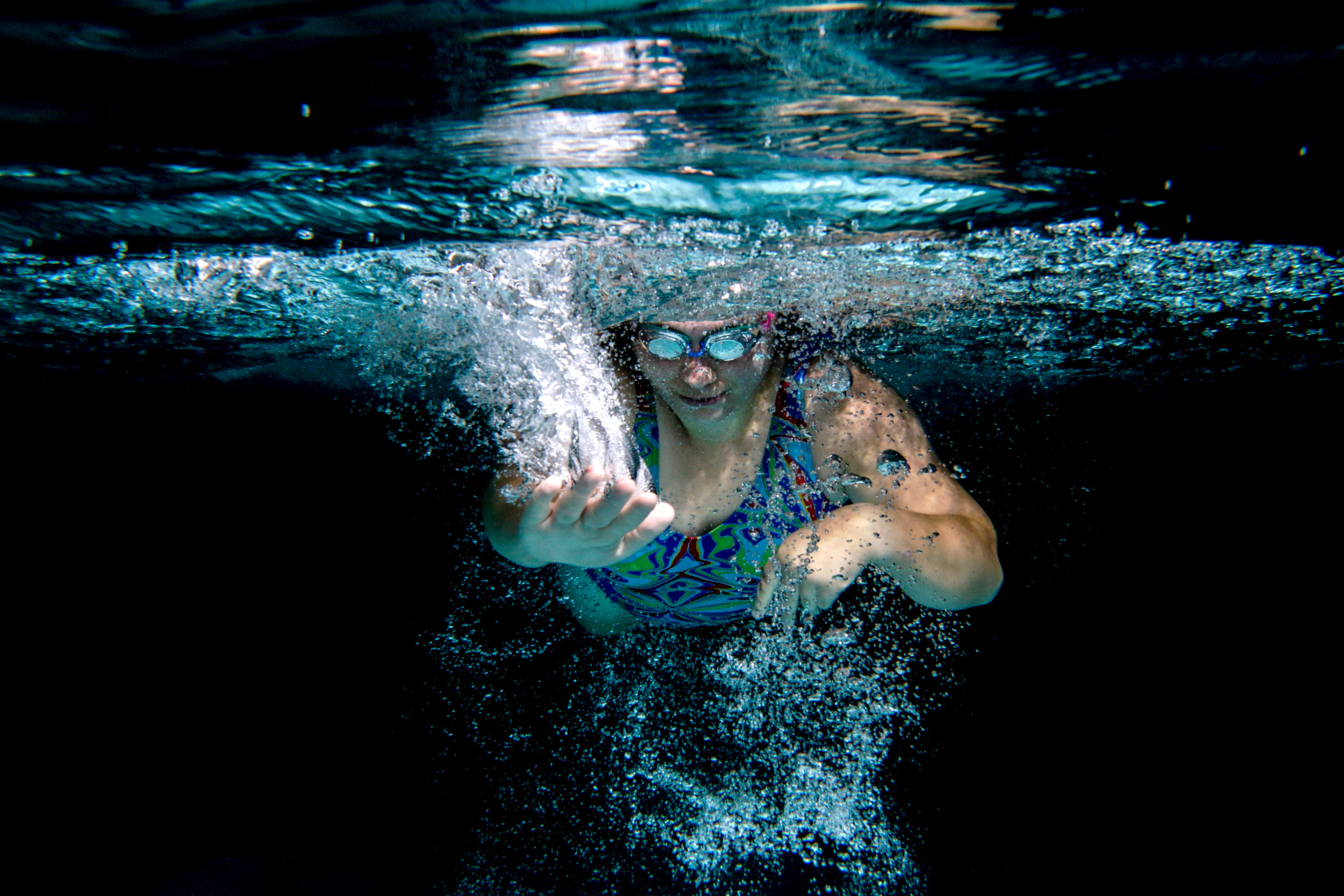Special Olympic athlete on the Upper Valley Hawks team Rose Kerrigan, of White River Junction, Vt., swims through the water at CCBA's Witherell Recreation Center in Lebanon, N.H., on Friday, Aug. 31, 2018. When it comes to important moments, Kerrigan thinks back to the bronze medal she won in the 100 meters in swimming. The medal was important not because it was her first, but because her family was there to watch.