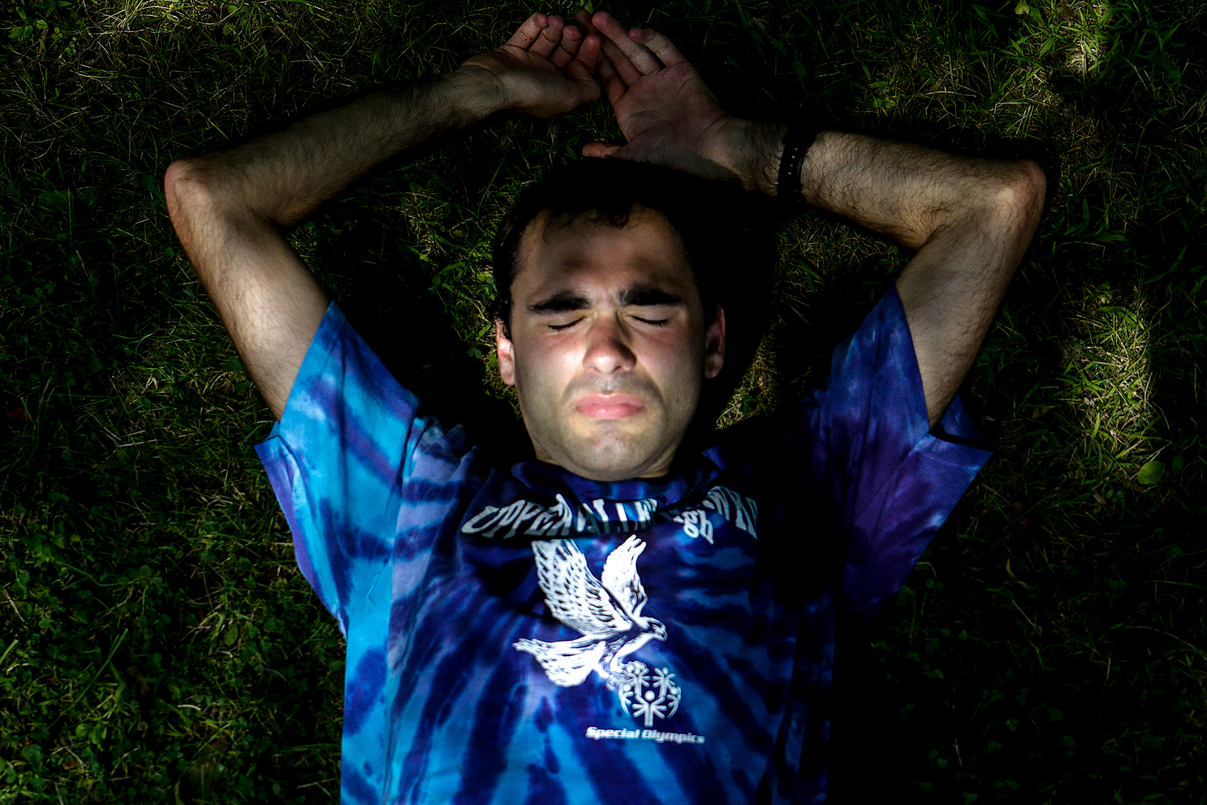 """Special Olympic athlete of the Upper Valley Hawks Walter Mosenthal, of Norwich, Vt., stretches after a run at the Hanover High School track on Saturday, Aug. 18, 2018. """"Not everyone would recognize someone with special needs,"""" Mosenthal said. But in the Hawks he has found a second family. Mosenthal thinks back to when he invited the team over to his house after he graduated high school. His teammates being there showed him how much they cared. """"It wasn't just for the athletics. We're not just team players, we're friends,"""" Mosenthal said."""