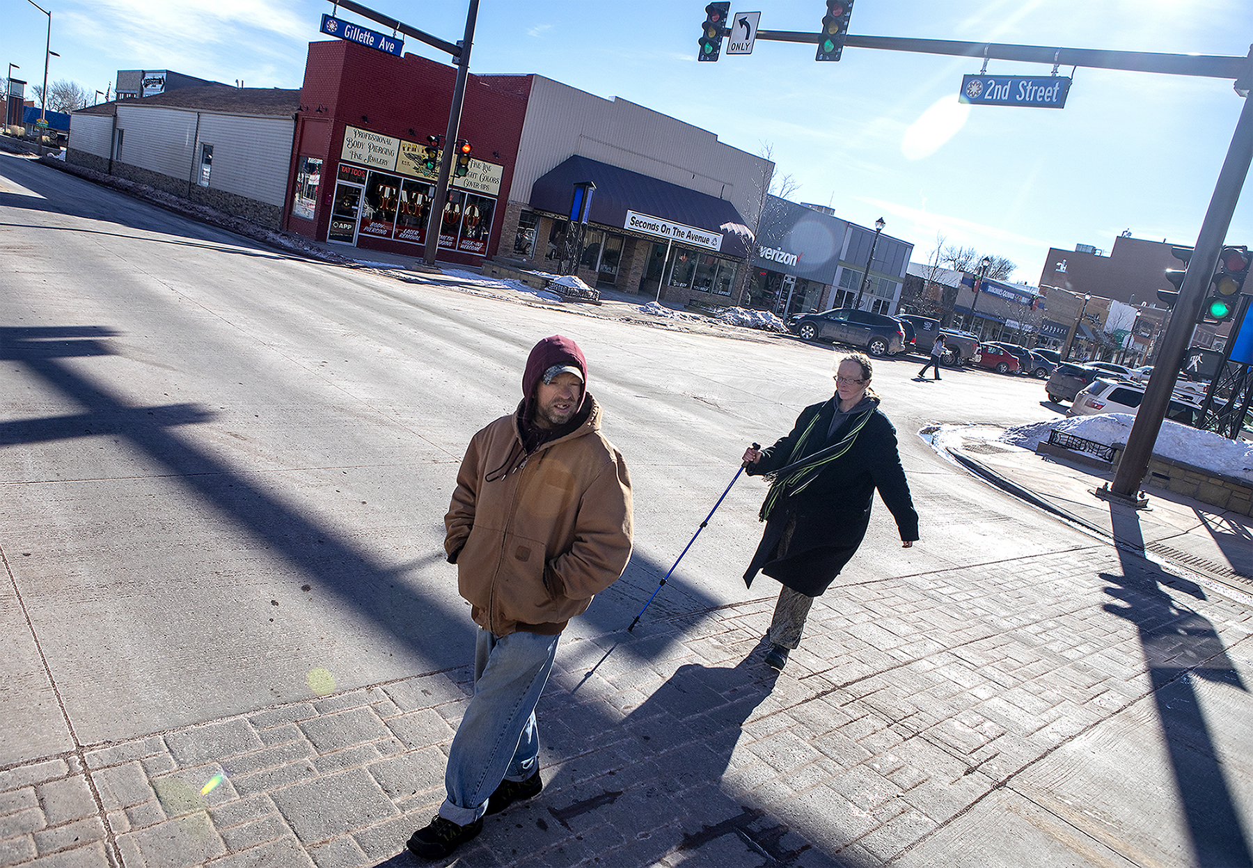 Andrea and Jeff cross second street on their walk to the Gillette Soup Kitchen on Wednesday, Jan. 30, 2019. Andre usually tries to avoid the main roads on their walks and stays vigilant of cars. They have seen a number of people, including two of Dan's street daughters, die by collision.