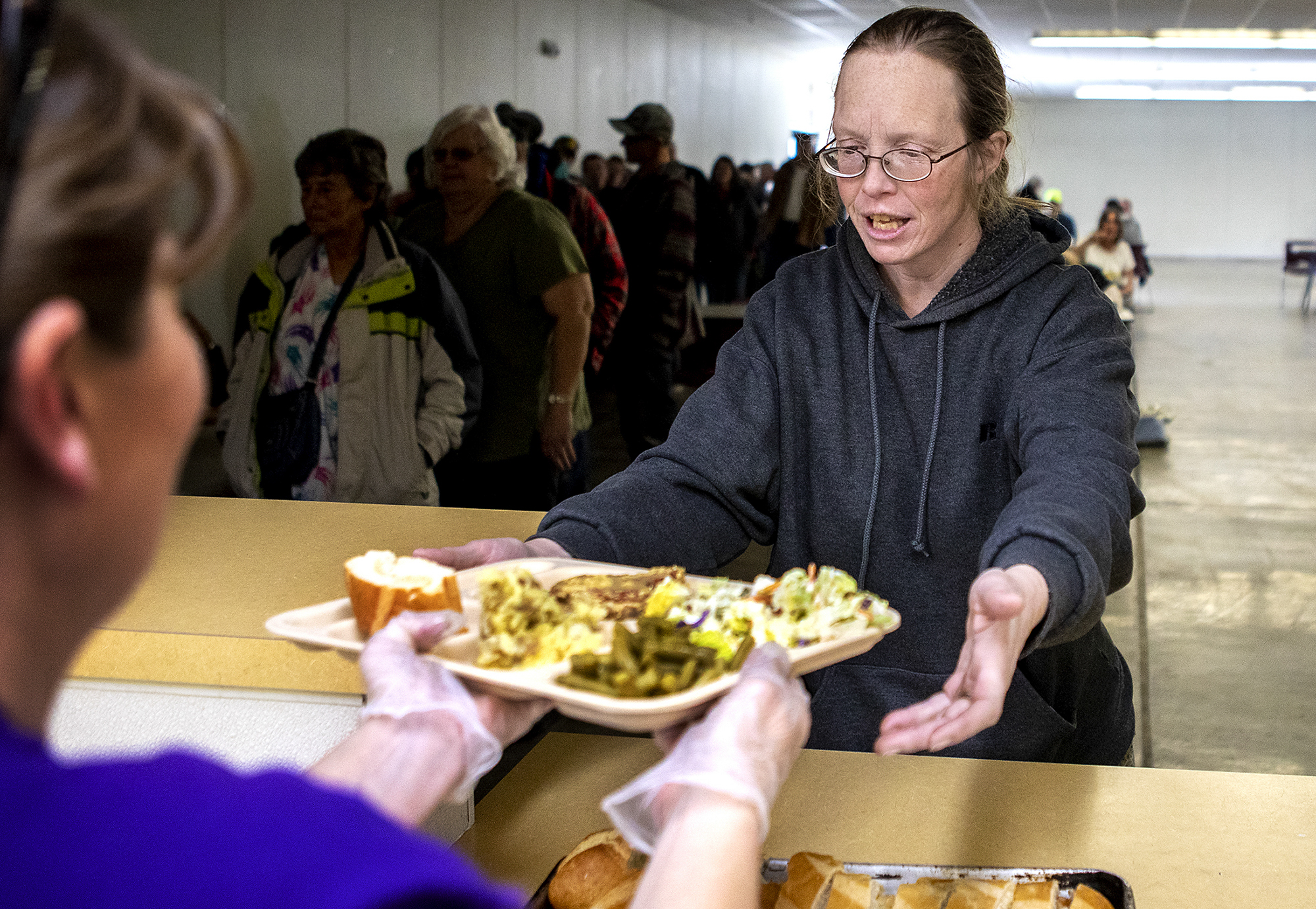 "Andrea receives a tray of food at the Gillette Soup Kitchen. The meal is their one hot meal of the day. Resources offered by the Council of Community Services like the soup kitchen have been a great help to Andrea and her family. ""There is hope out there,"" Andrea said."