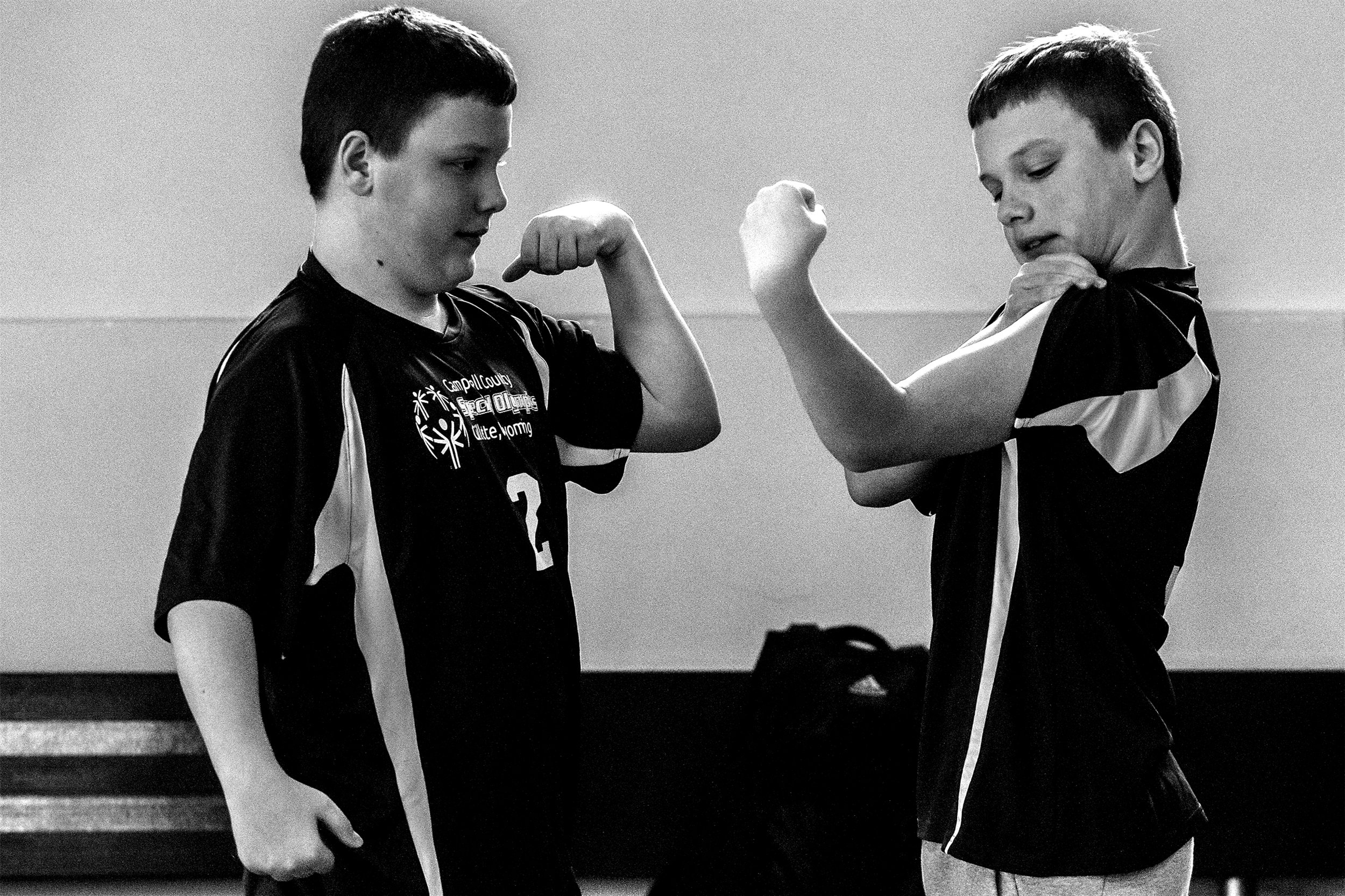 Brothers Levi, left, and Lucas Kyle, both 12, compare their muscles ahead of the Special Olympic Area Games on Thursday, April 11, 2019, at the Rec Center. The brother said they enjoyed basketball, swimming, soccer and bowling.