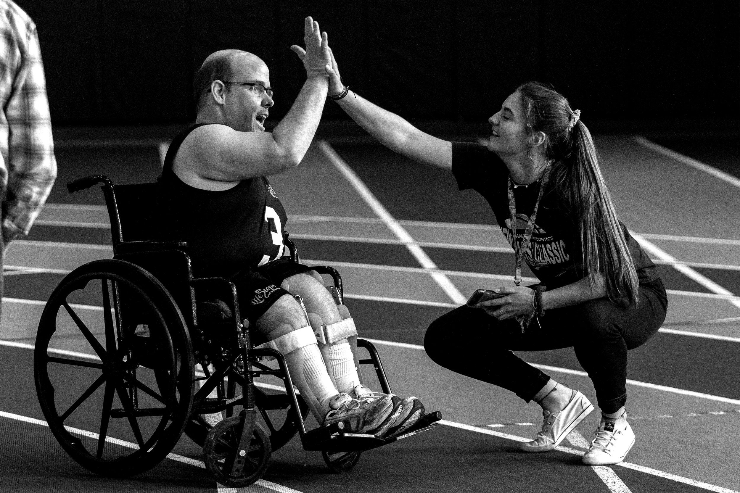 Jeff Mock receives a high five from his timekeeper Livia Castellanos after his race in wheelchair obstacle at the Rec Center on Friday, April 12, 2019. Mock was also one of two athletes to compete in weightlifting.