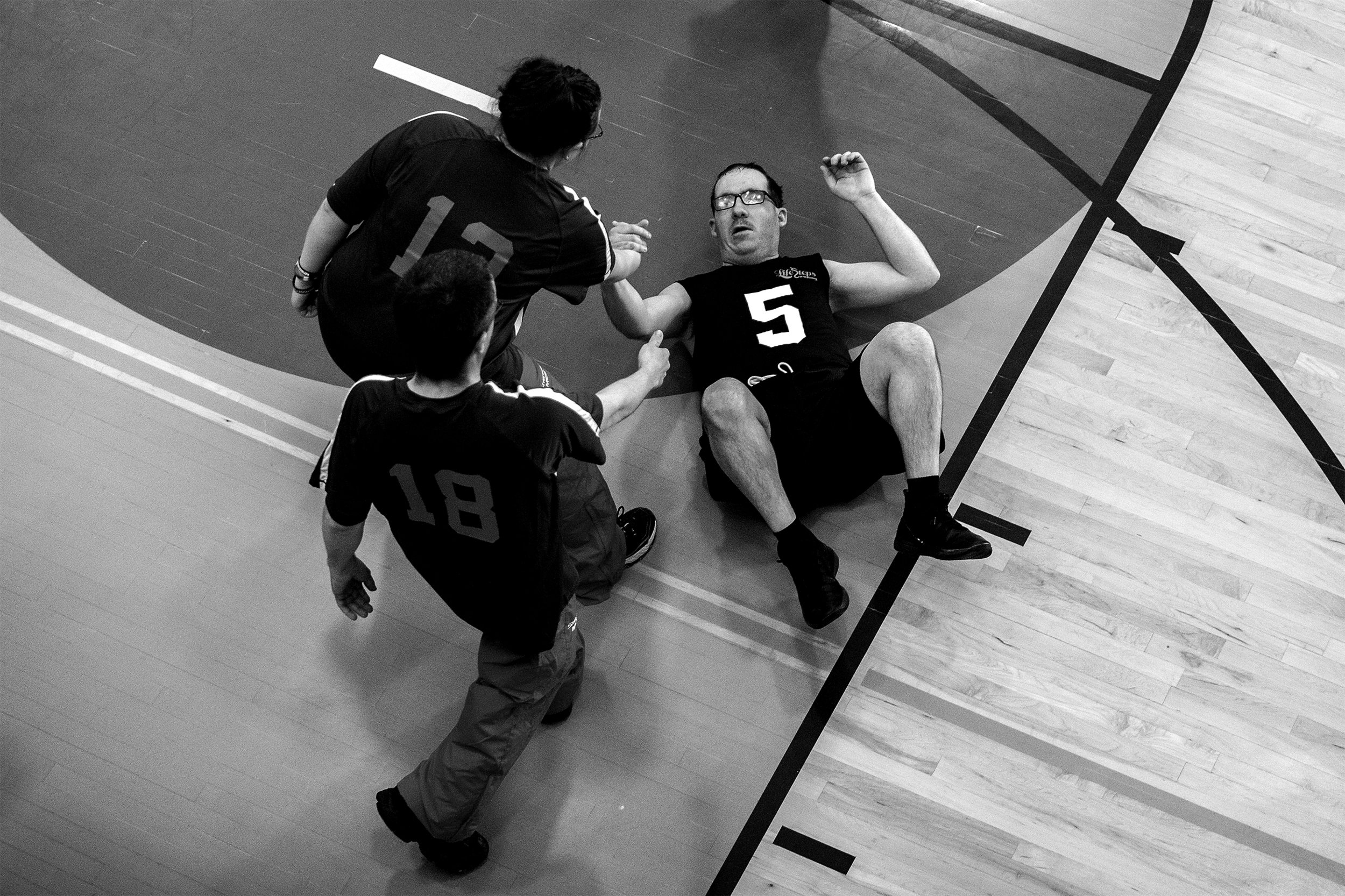 Billy Buckey is helped to his feet by rival players Amber Trieber and Jackson Ventling, (18) during the basketball competition of the Special Olympics Area Games on Thursday, April 11, 2019. For many of the athletes competing the family and camaraderie aspect is far more important than winning.