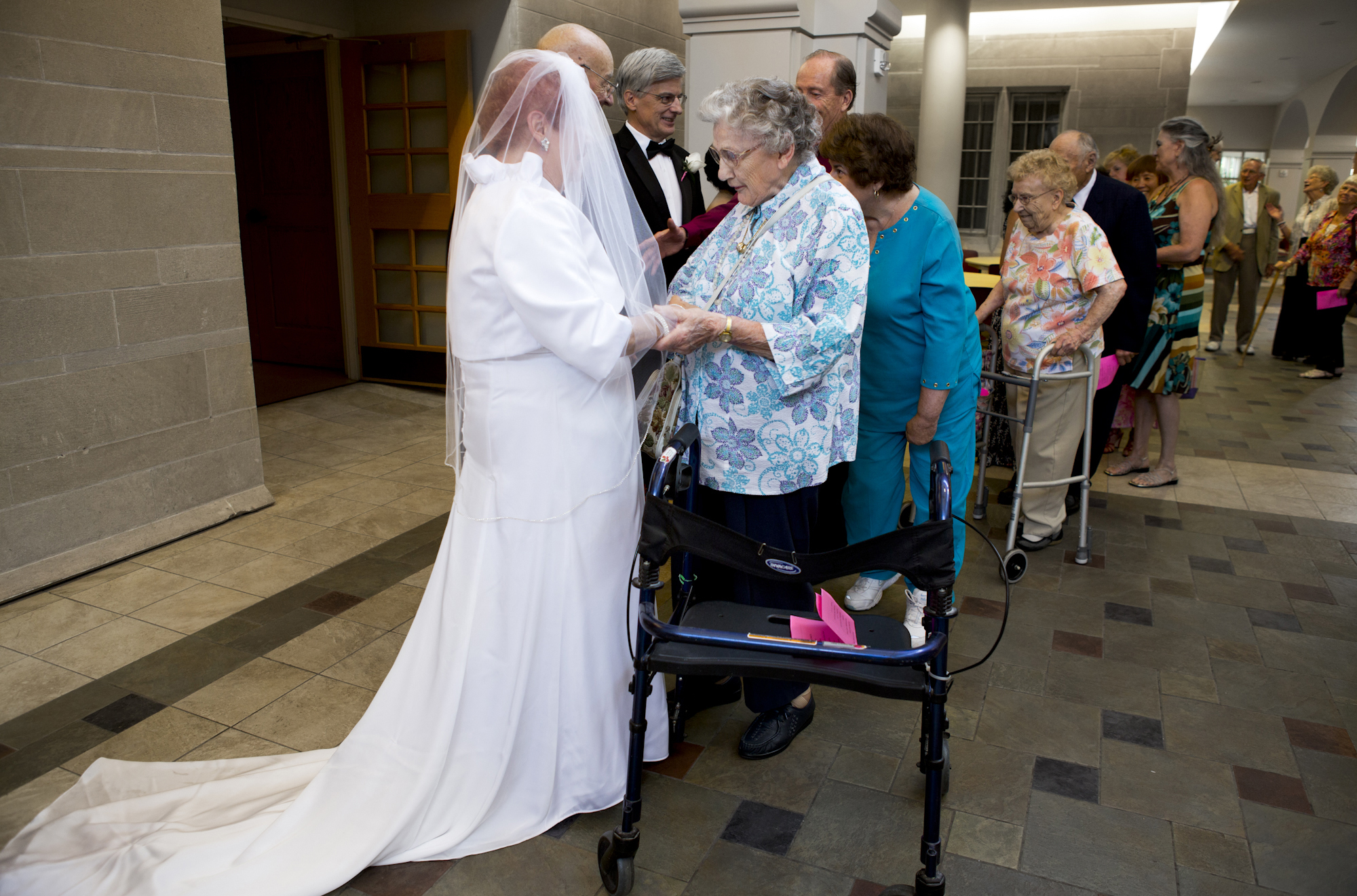 Friends and family line up to congratulate Joyce and Frank after their wedding at Sacred Heart Cathedral.