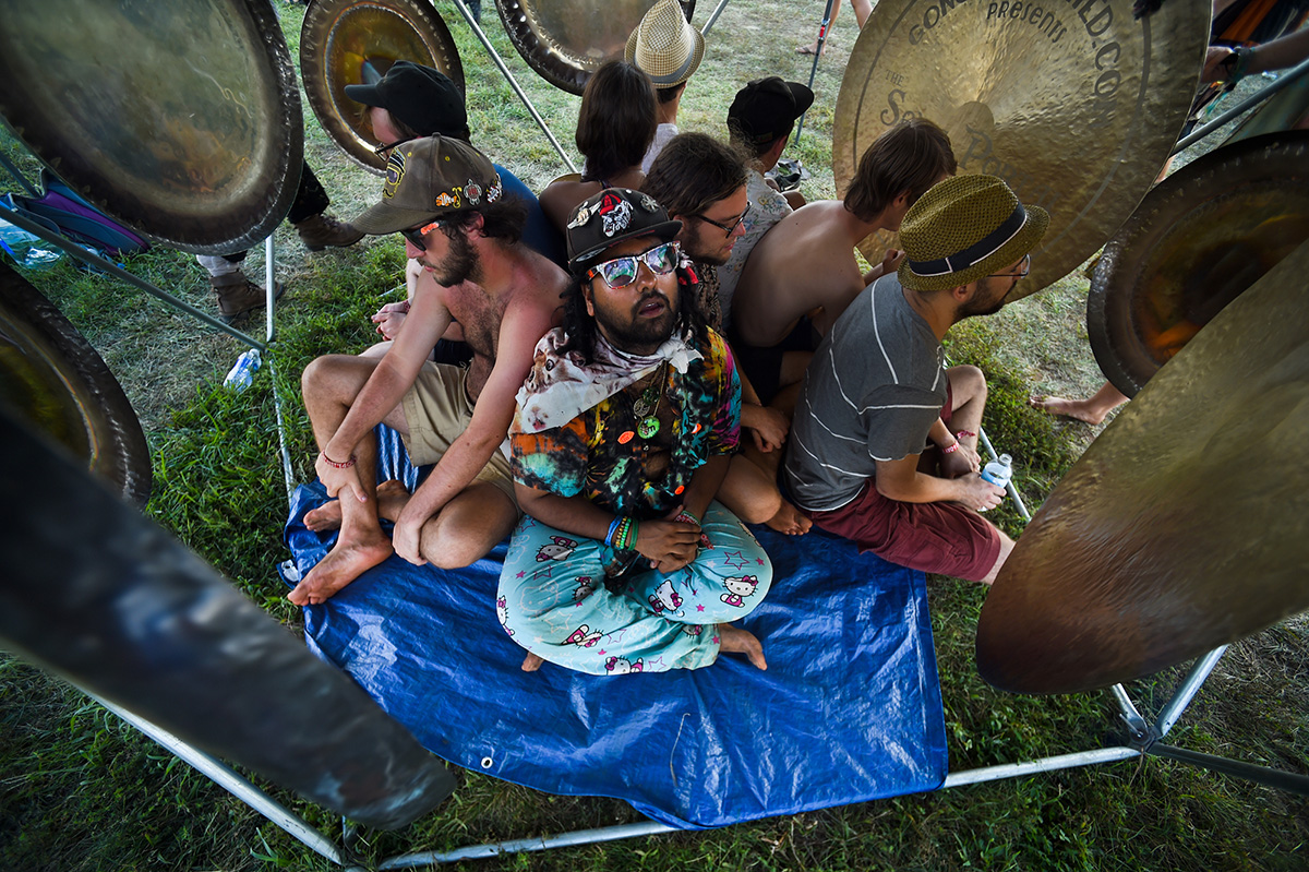 "Mark Baksh joins friends in the ""sonic portal spaceship,"" encircled by vibrating gongs set up to help festival-goers relax at the Lockn' music festival in Arrington, Va. Baksh said the experience felt like a ""brain massage."""