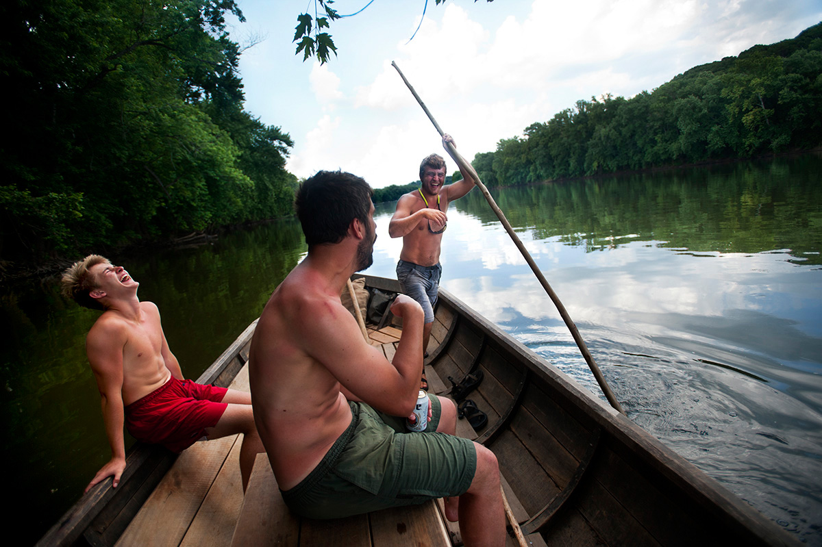 Tim Morton (from left), 15, Charlie Craighill and Andrew Shaw share a laugh as Shaw uses a long pole to help the Mary Marshall gain speed as they head down the James River during the fifth day of the 29th annual James River Batteau Festival. The 120-mile journey — from Lynchburg to Maiden's Landing — features 18 crews who navigate wooden batteaux resembling the 18th- and early 19th-century cargo boats.