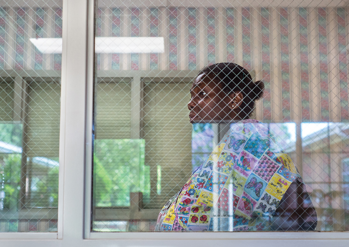 """Ruby rests for a moment while working at The Carrington. """"How can I be a good mom when I'm working everyday, working overtime?""""she asked. Ruby is currently on a waiting list for low-income housing, which will help reduce her monthly expenses, after The Lynchburg Redevelopment & Housing Authority approved her application."""