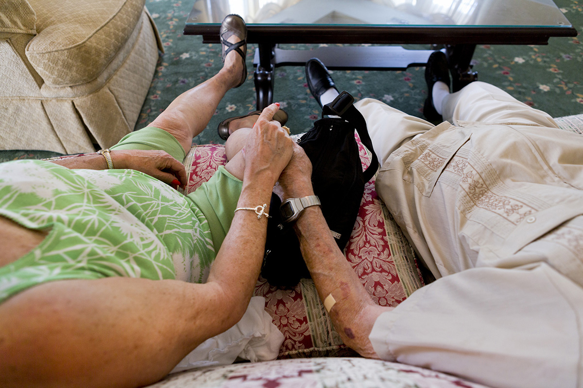 Joyce Kleber, 71, and her fiancé, Frank Maslyn, 95, hold hands while waiting for a musical performance at Legacy Senior Living Communities in Greece, N.Y.