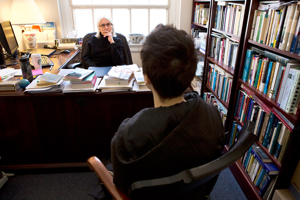 Bosch meets with their Philosophy Professor, Nina Mikhalevsky, during her office hours to discuss that Bosch does not want to be called 'Kaitlin' during class.