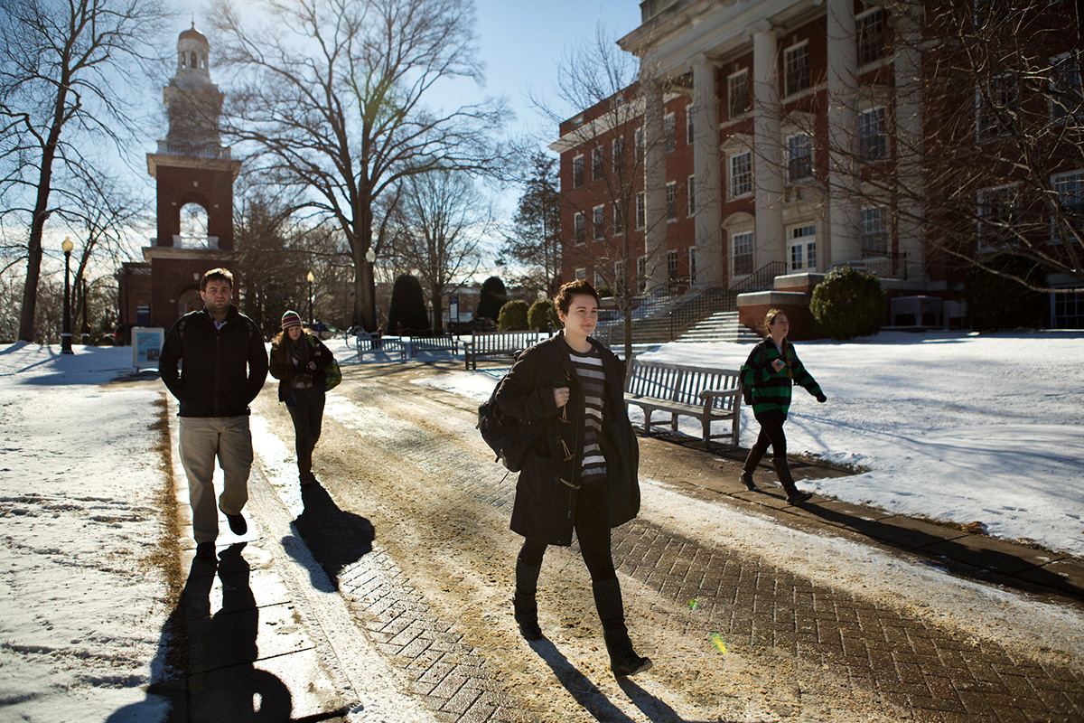 "Bosch walks through campus to meet with their Philosophy Professor, Nina Mikhalevsky, during her office hours to discuss their preferred name, at the University of Mary Washington. ""Somedays I don't feel like I have a gender at all, somedays I feel like a robot,"" said Bosch."