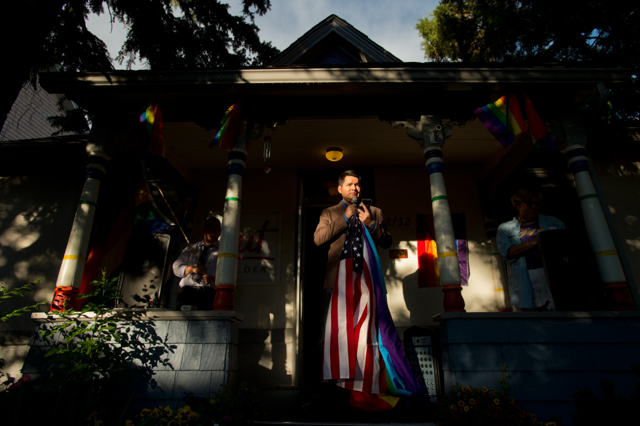 Ray Rodriguez, a member of the board of directors for Out Boulder, speaks during a vigil held in Boulder, Colo. for the victims of the mass shooting at the gay nightclub Pulse in Orlando, Fla.