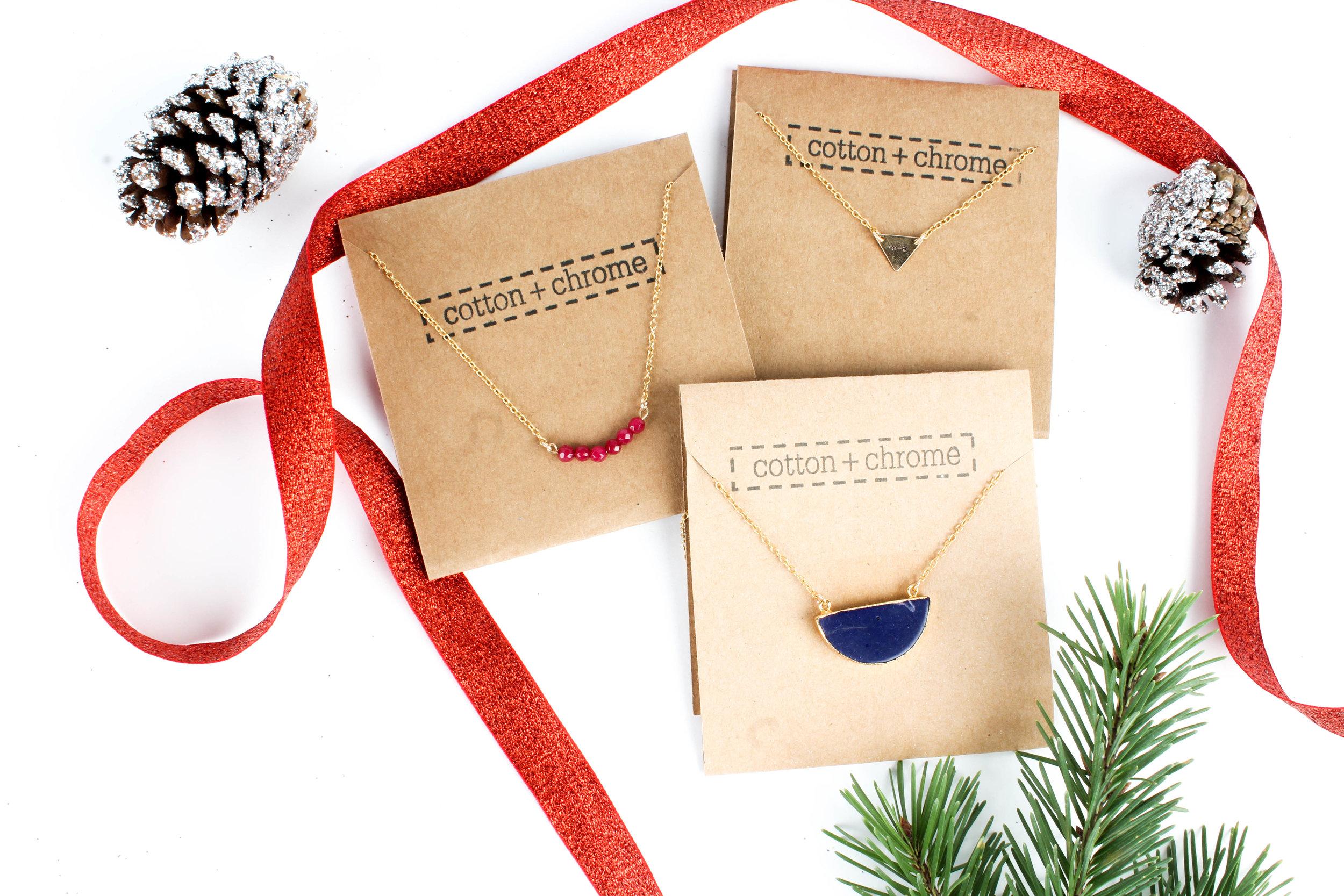 Necklaces: Gold Gemstone (Blue) $45.50 Gemstone Bar (Red) $41.50 Gold Triangle $41.50