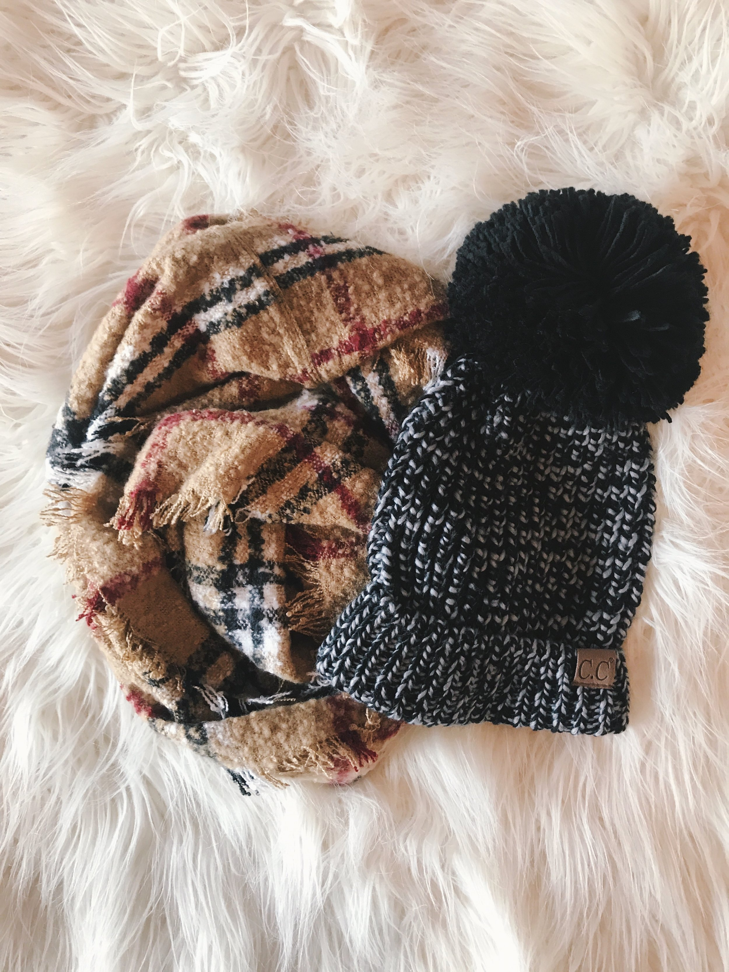 Warm & Cozy - Who doesn't enjoy a cozy gift on a cold winter night. We have a TON of hats, scarves and mittens to add into your loved ones stocking or pair it with a larger item for a full gift they'll use all season long.Hat: $25.00Scarf: $20.00