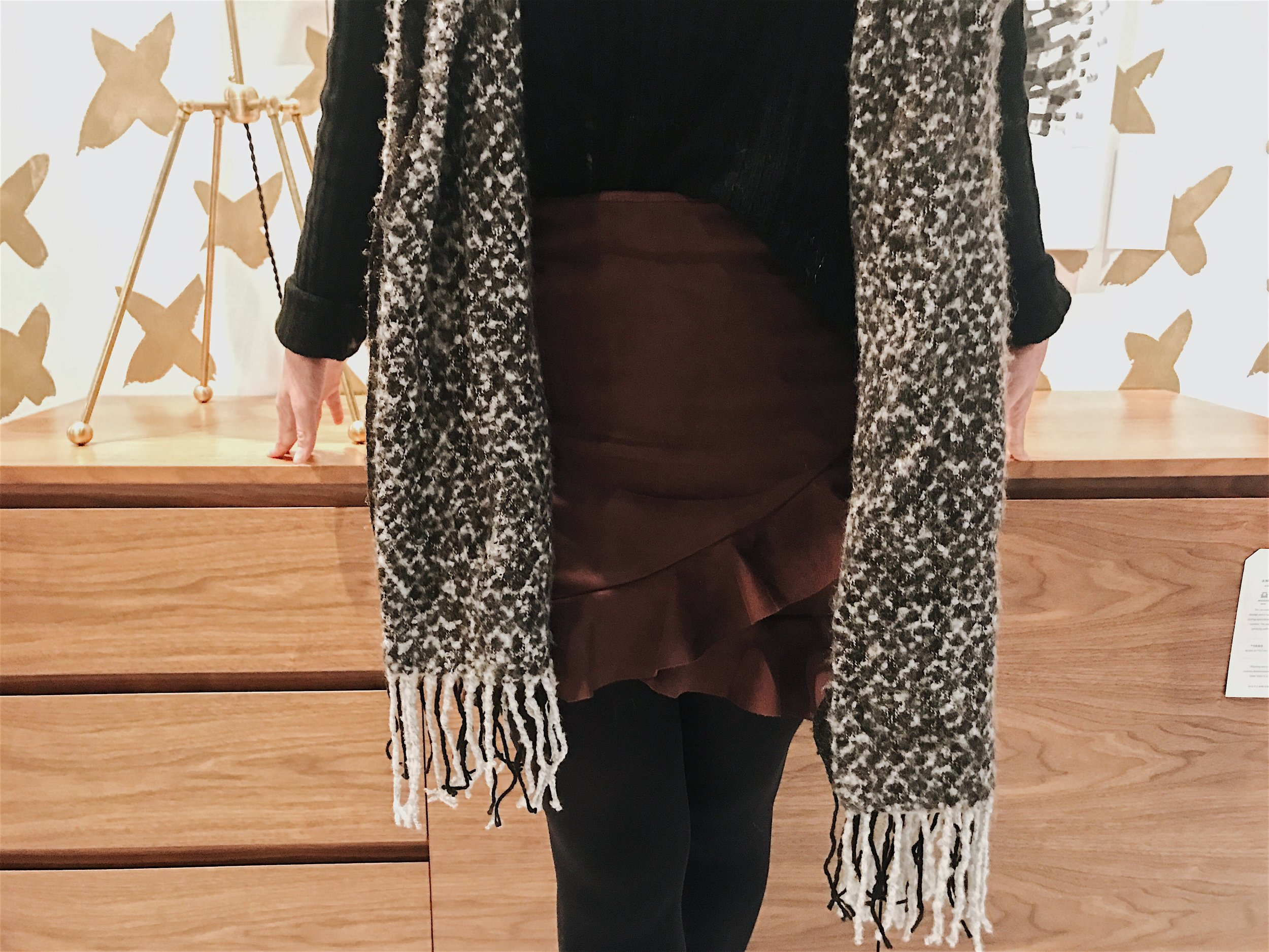 Stargazing Distressed Sweater $54.00   Move Over Ruffle Mini Skirt $41.50